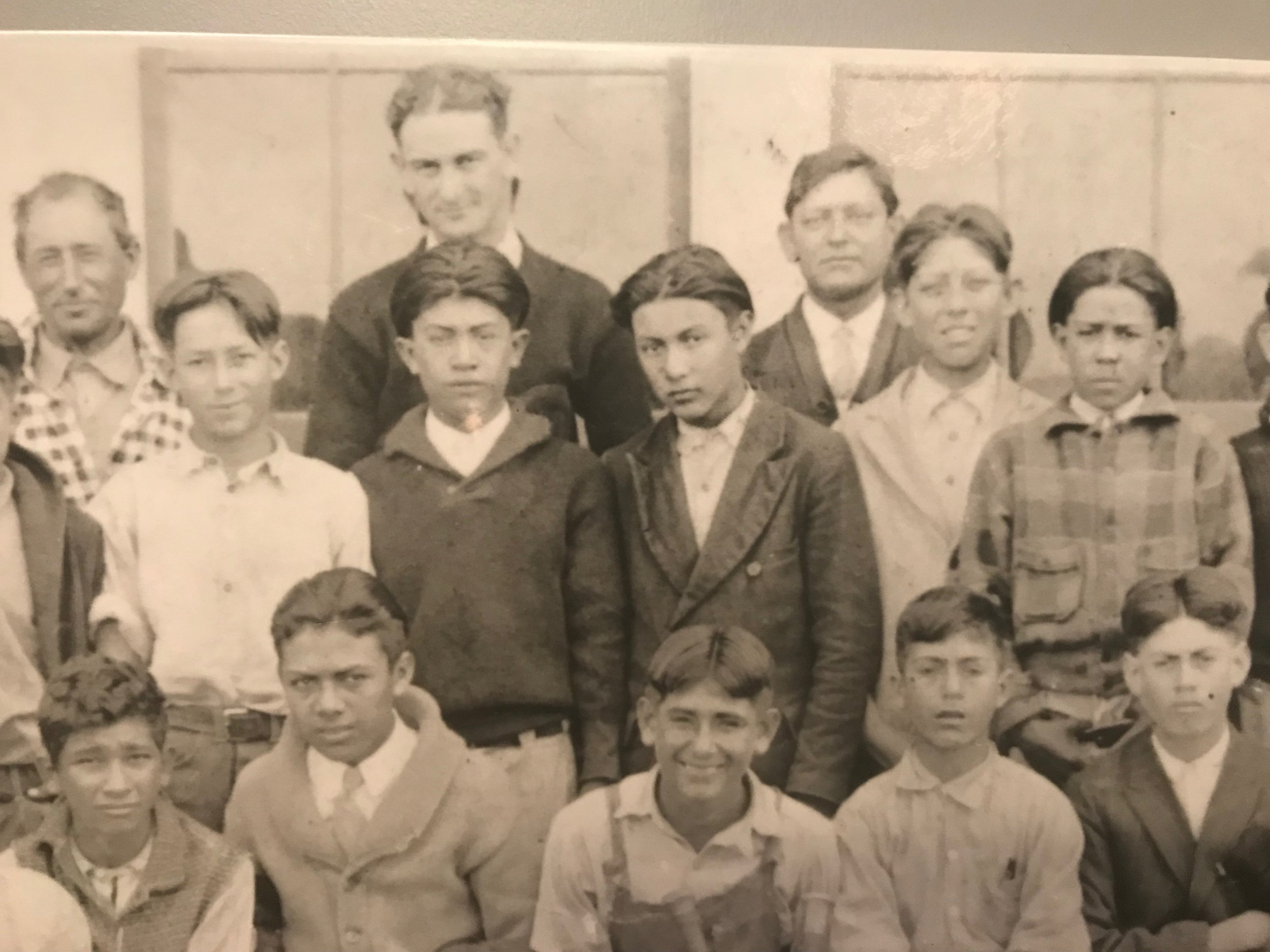 Young Lyndon Johnson with his students in Cotulla, Texas. He later said his experience in the poor Mexican-American community fueled his commitment to fight poverty and discrimination.