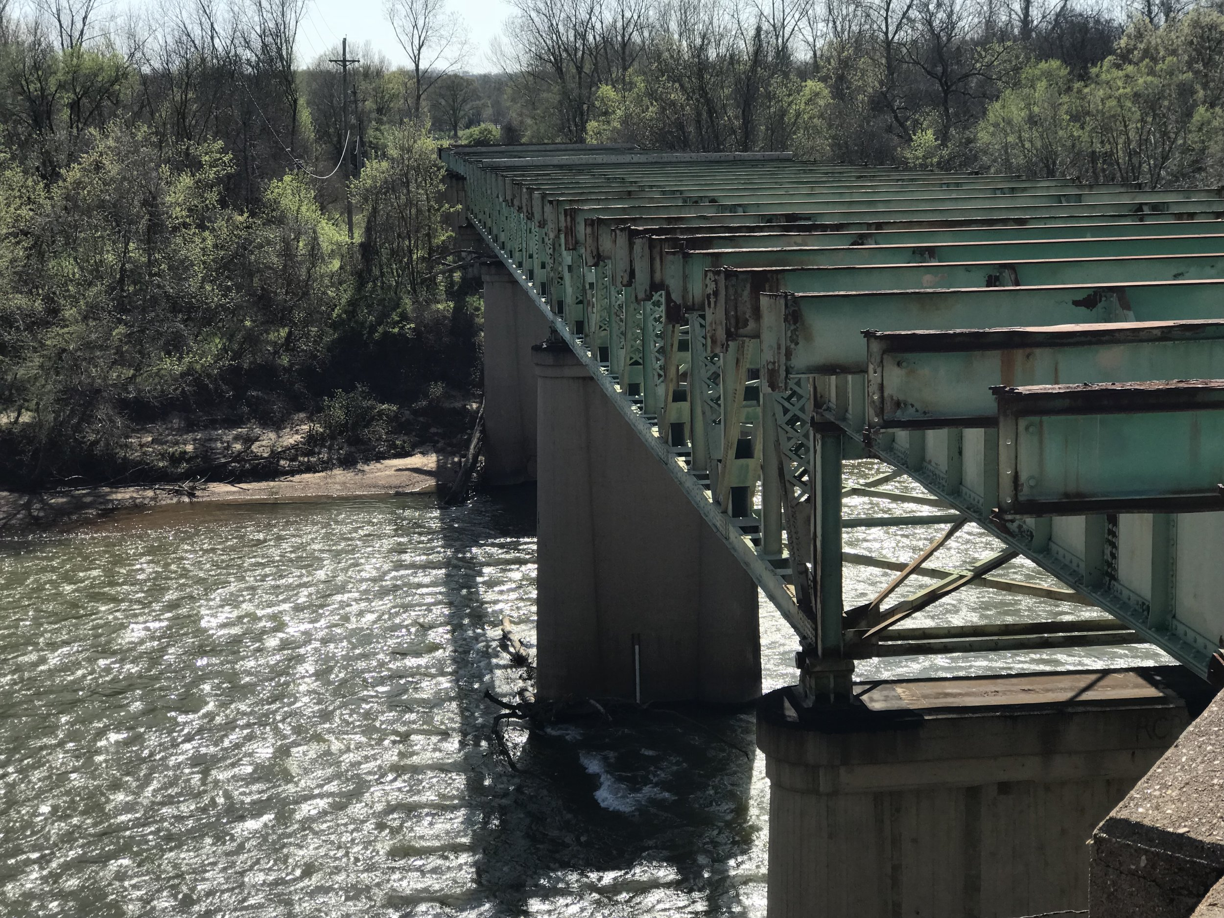 The Route 66 bridge over the Meramec River is a rusted skeleton. On the other end is where the town of Times Beach used to be.