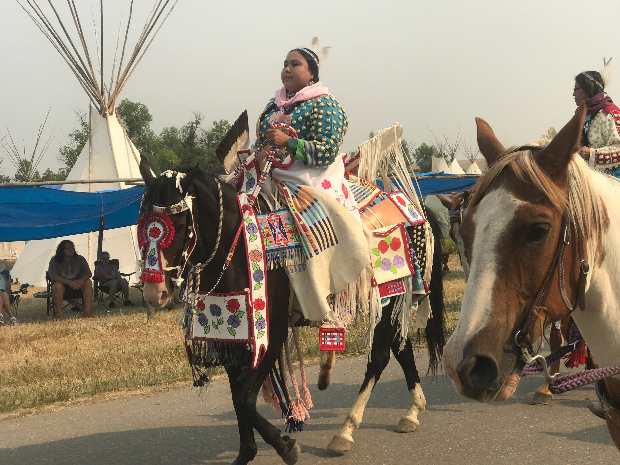 Parading through the encampment in Crow Agency, Montana.