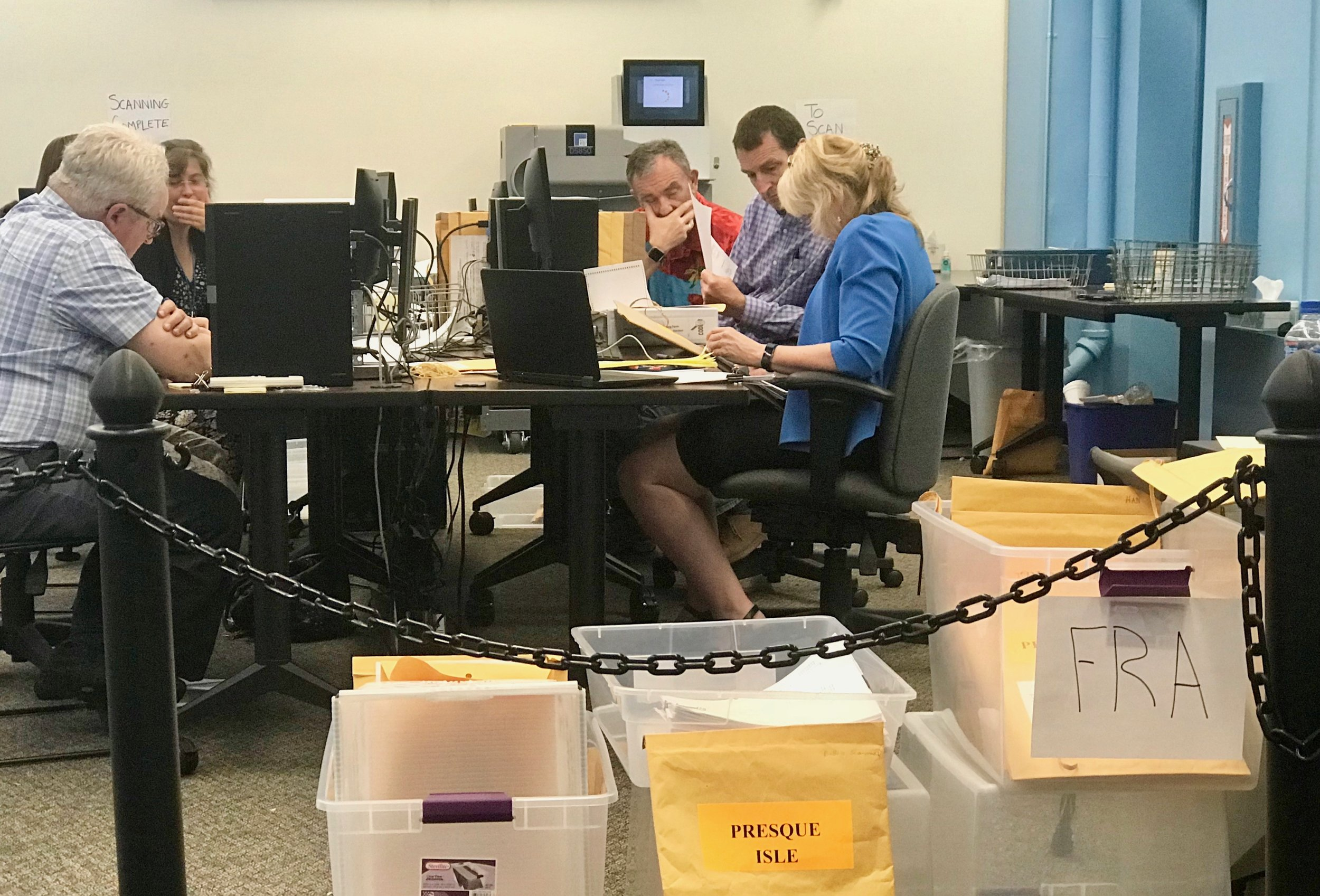 Maine election workers certify ballots before running the ranked-choice voting program to determine the final results of the June 12 primary.