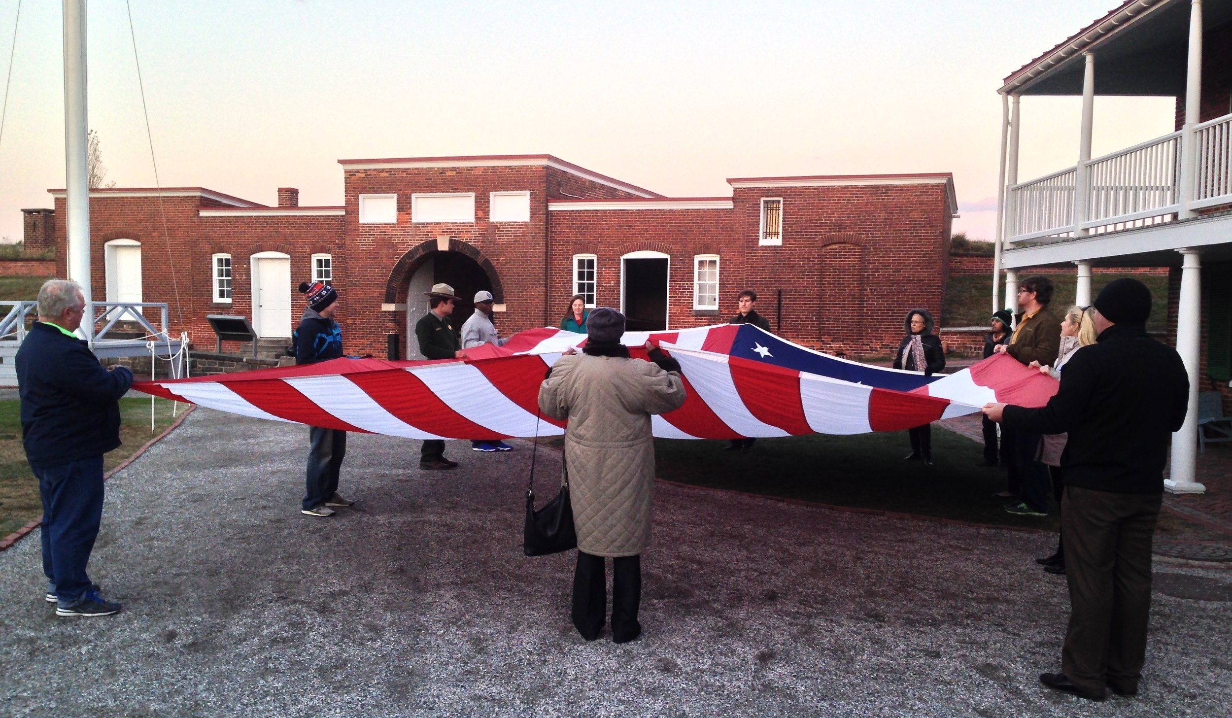 Folding the Star Spangled Banner at Fort McHenry.