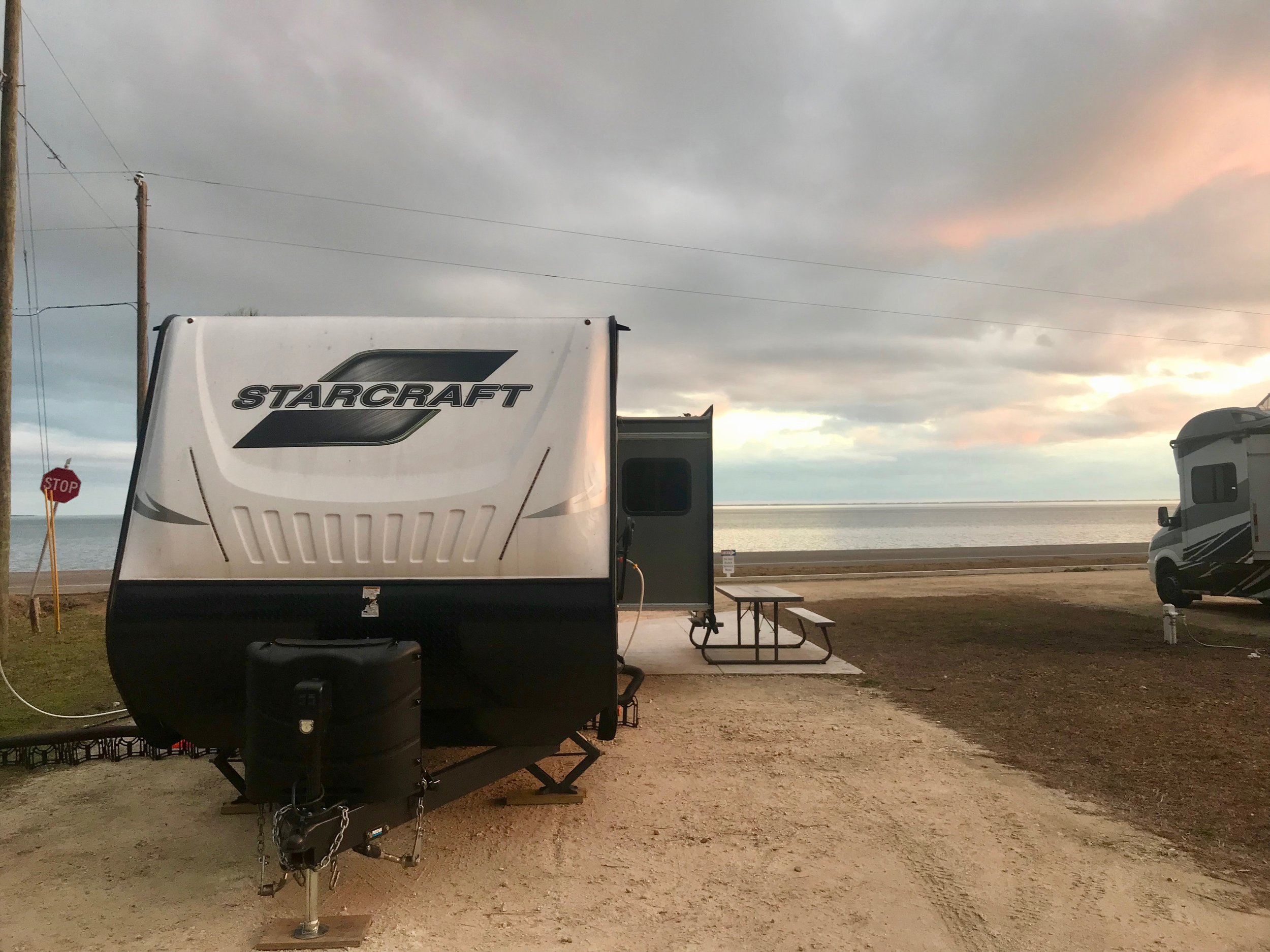 Our trailer, parked across Rte. 98 from the Gulf.
