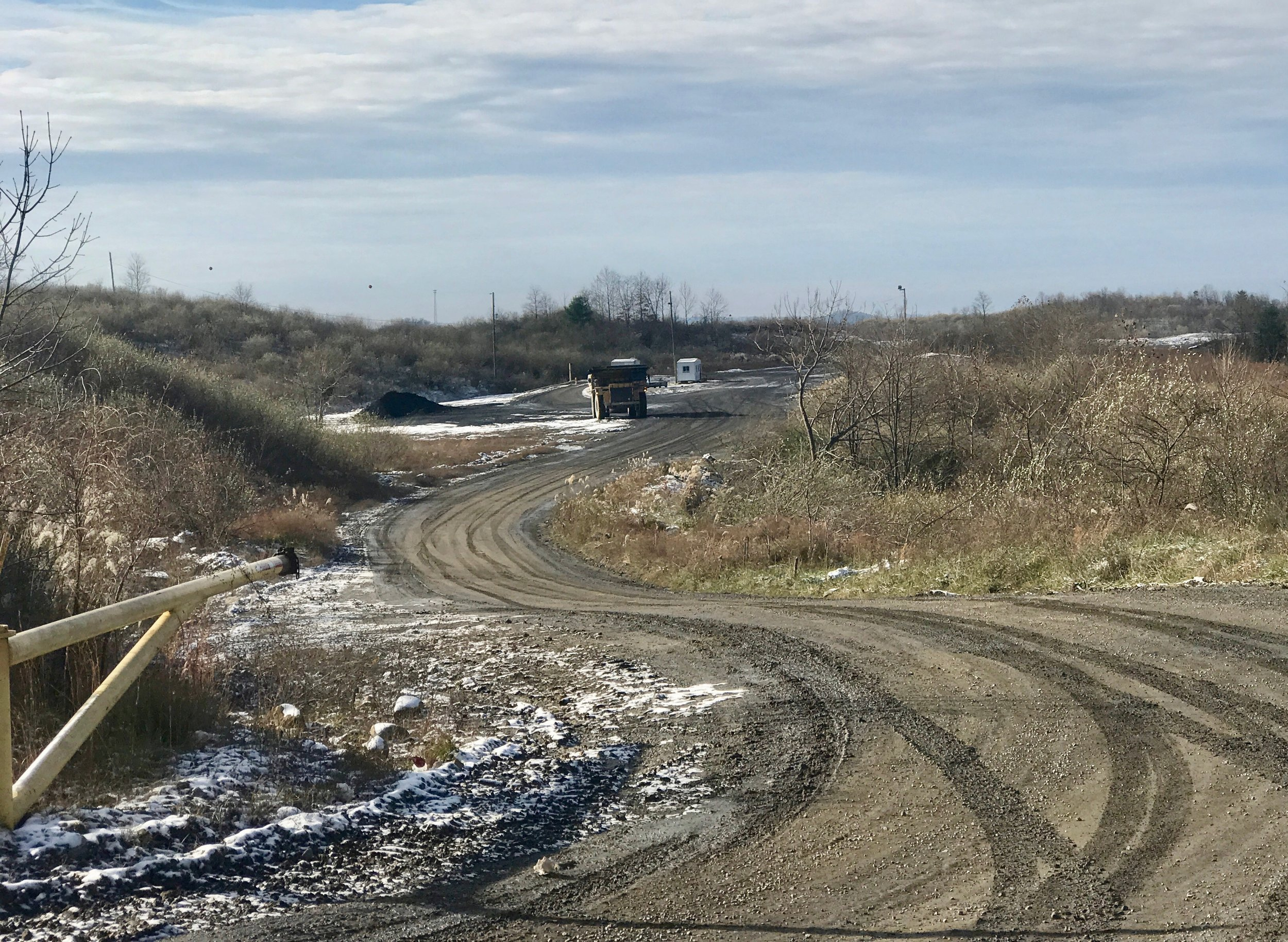A coal truck moves through the Bent Mountain surface-mining operation outside Pikeville, Ky. A $150 million solar energy project has been proposed for the site.