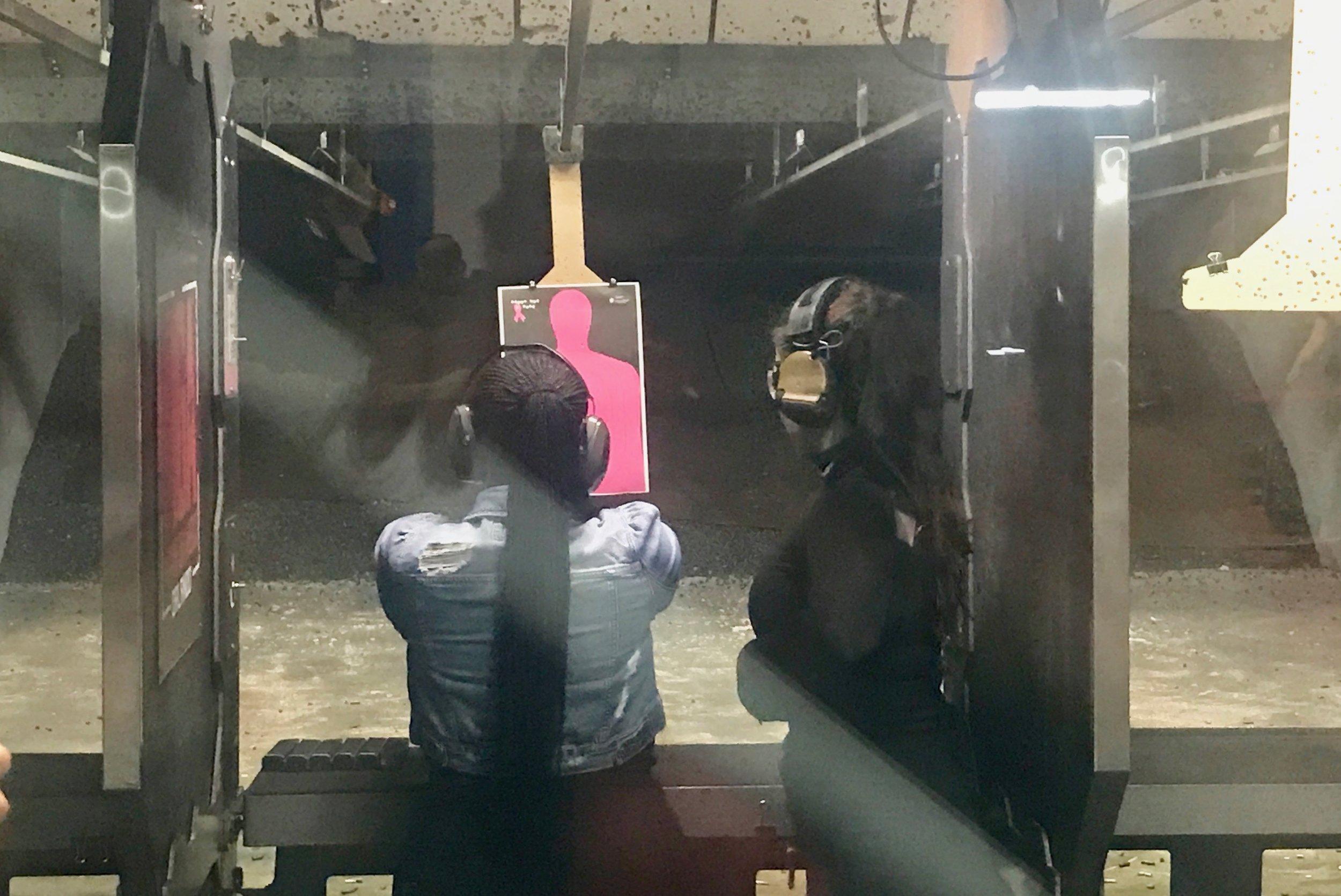 A customer lines up a shot at Machine Gun America.