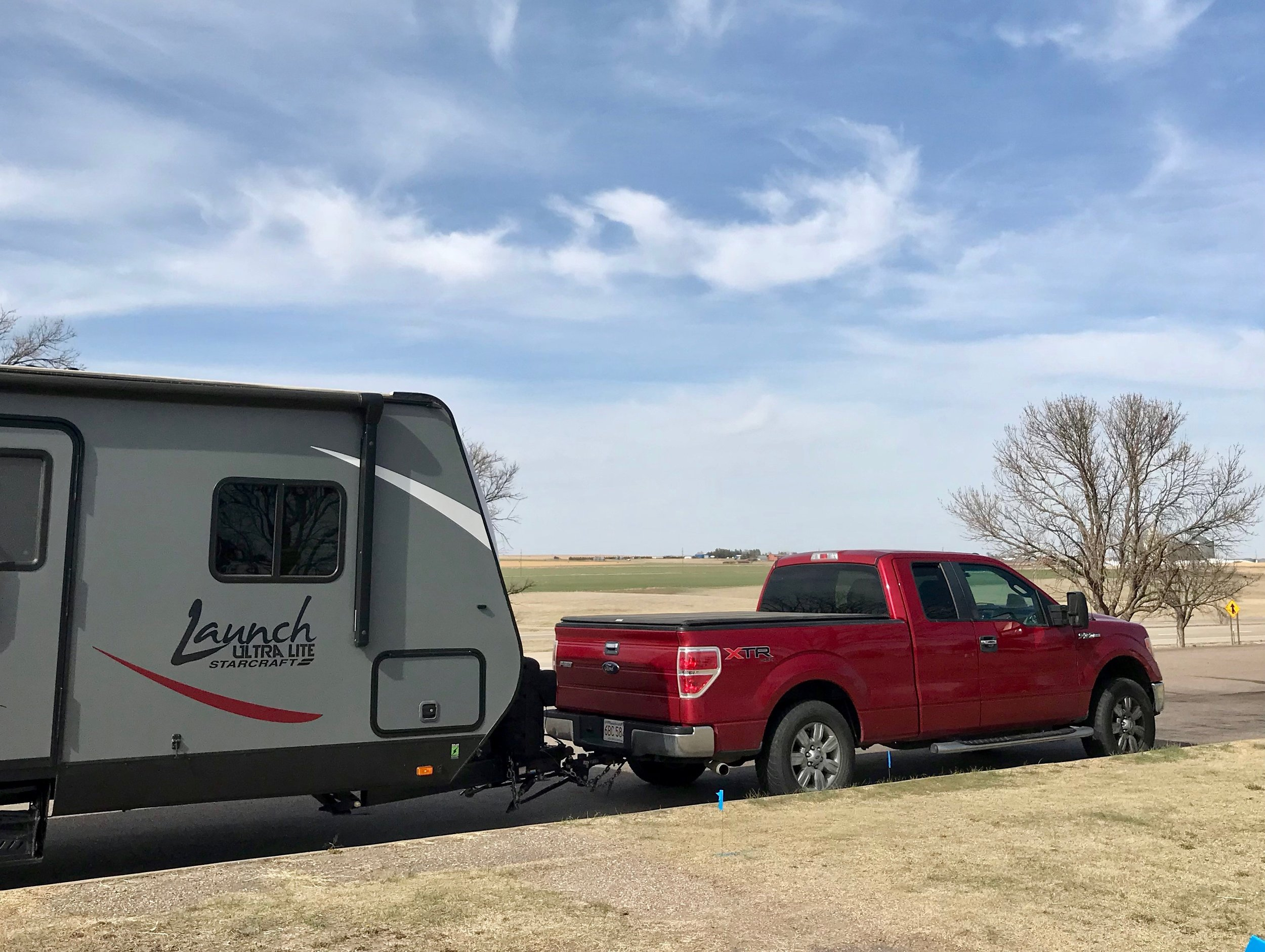 The writer's truck and trailer, on the flatlands of Kansas.