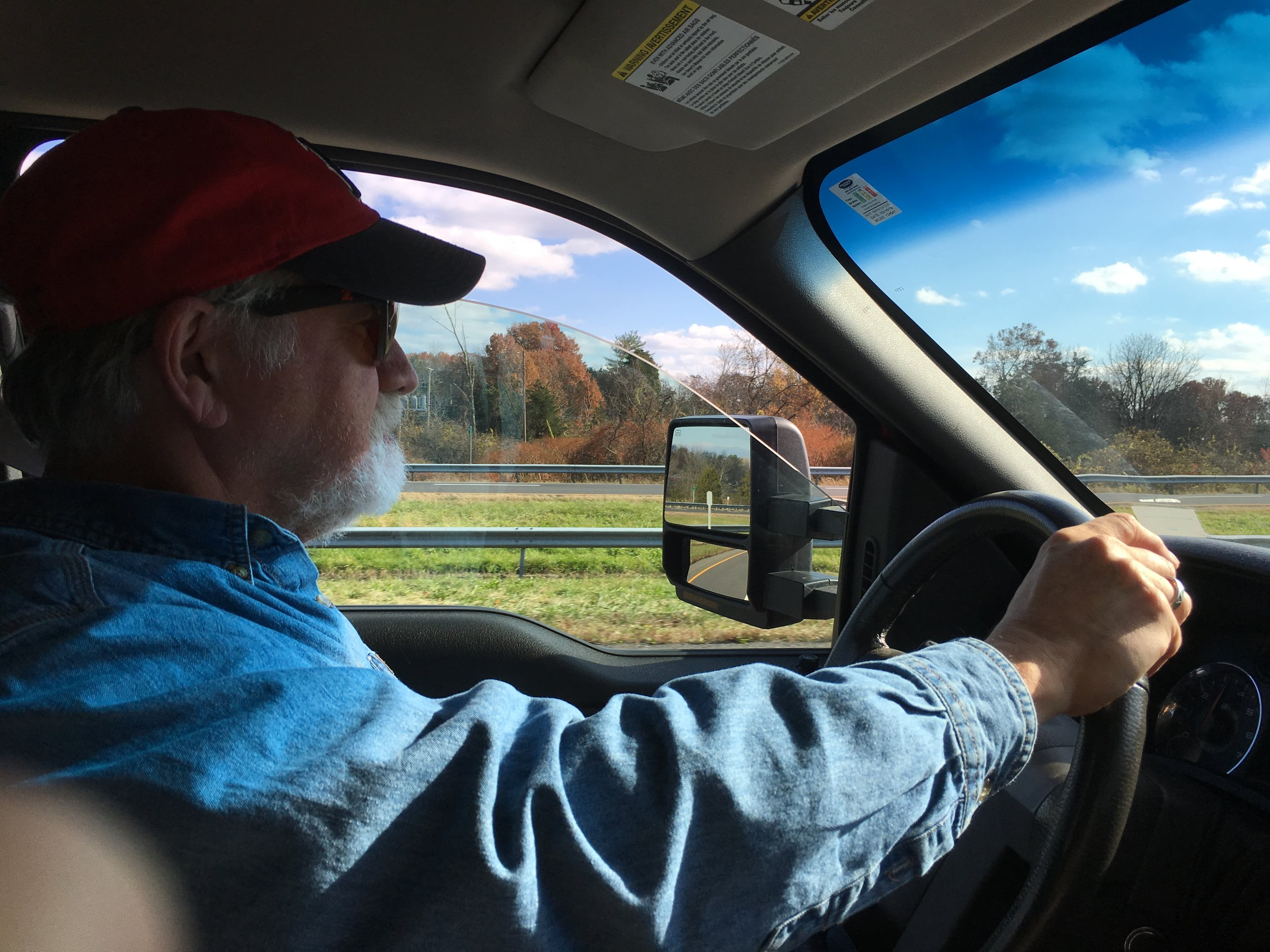 Columnist Rick Holmes behind the wheel of his truck, somewhere in the Midwest.