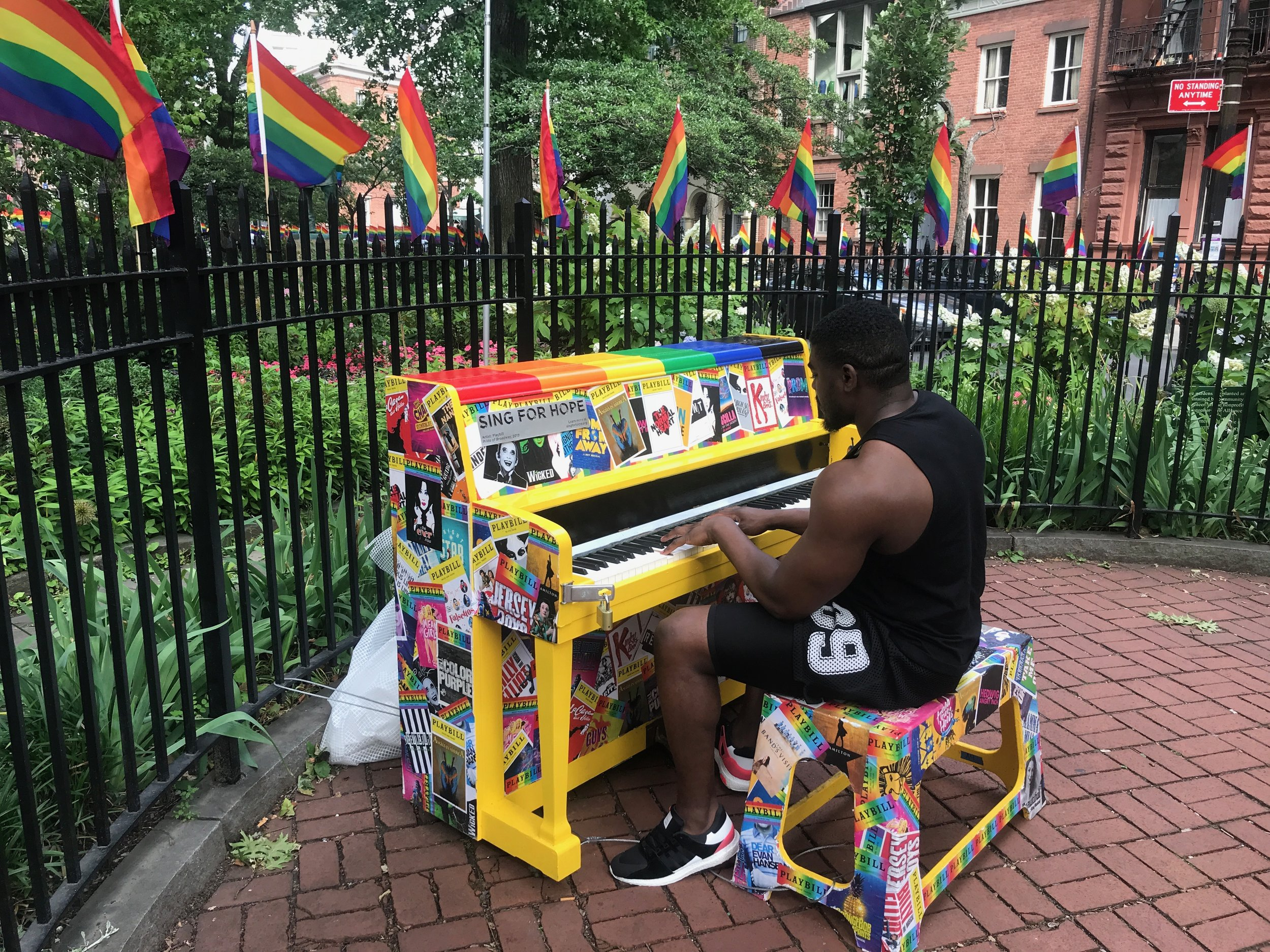 A piano player entertains visitors at Stonewall National Monument, across from the Stonewall Inn in New York's Greenwich Village.