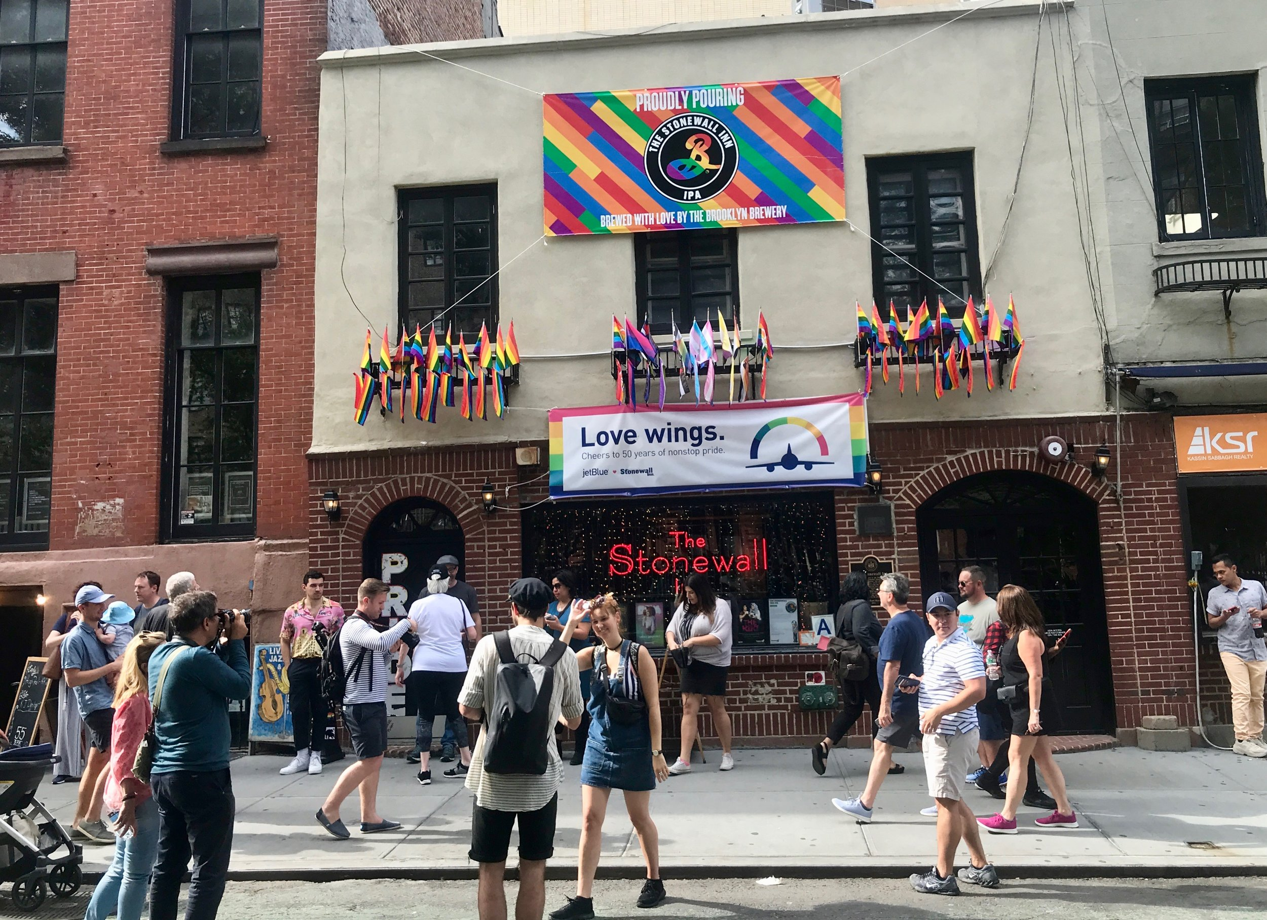 Tourists mill around New York's Stonewall Inn, the dive bar that was the site of street clashes in 1969 that helped launch the gay rights movement.