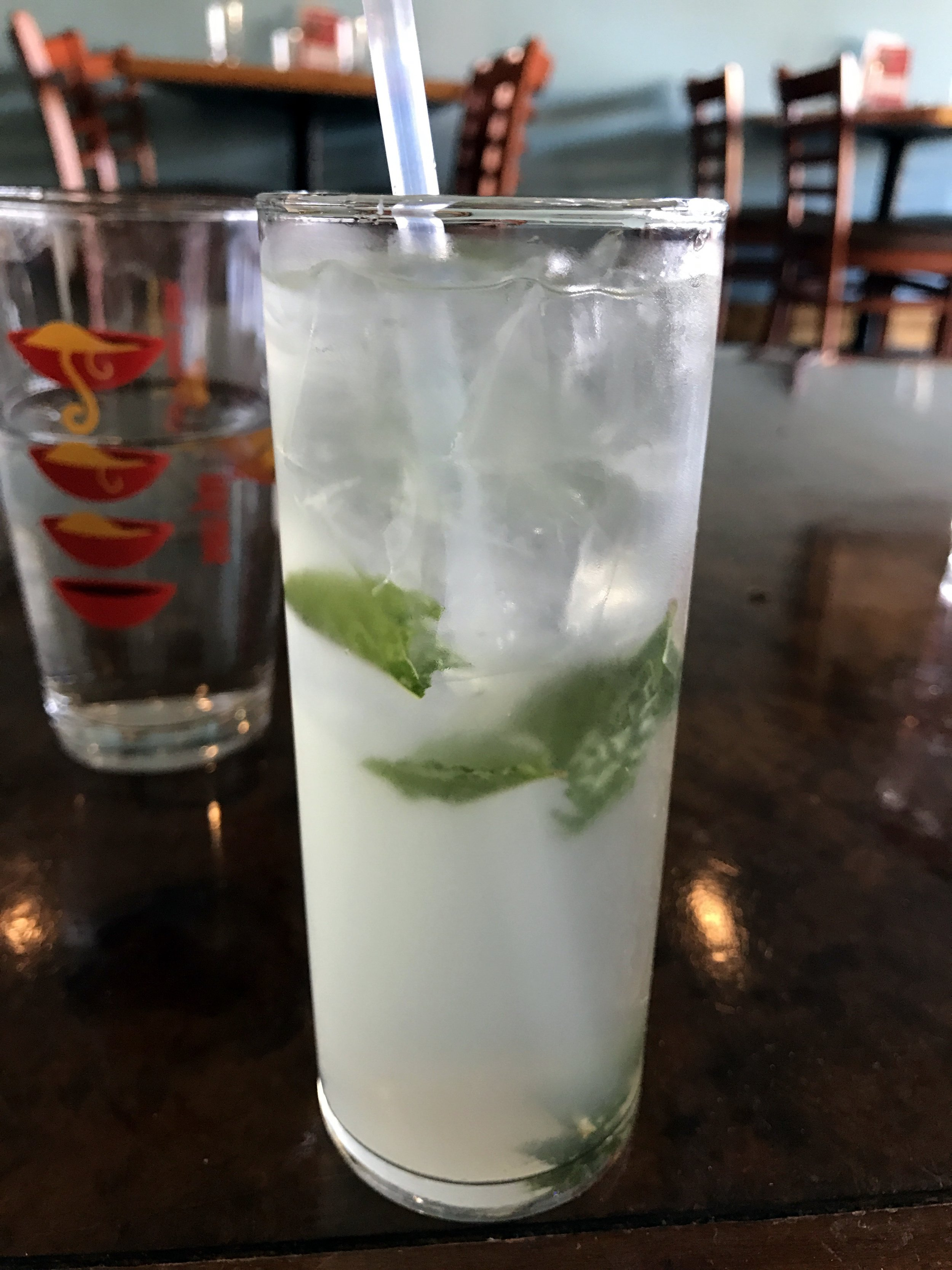 The Sugar & Spice: a white wine cocktail with mint, lychee, and a homemade Thai chili syrup