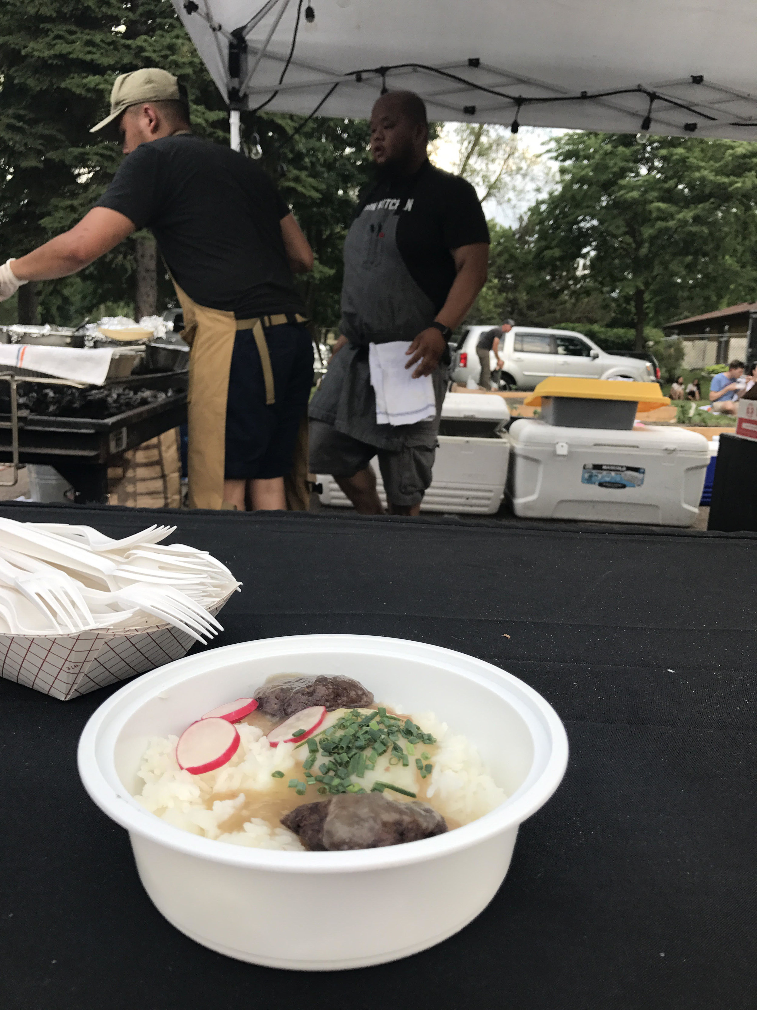 Loco Moco, cooked up by Yia (right) and team at Little Mekong Night Market