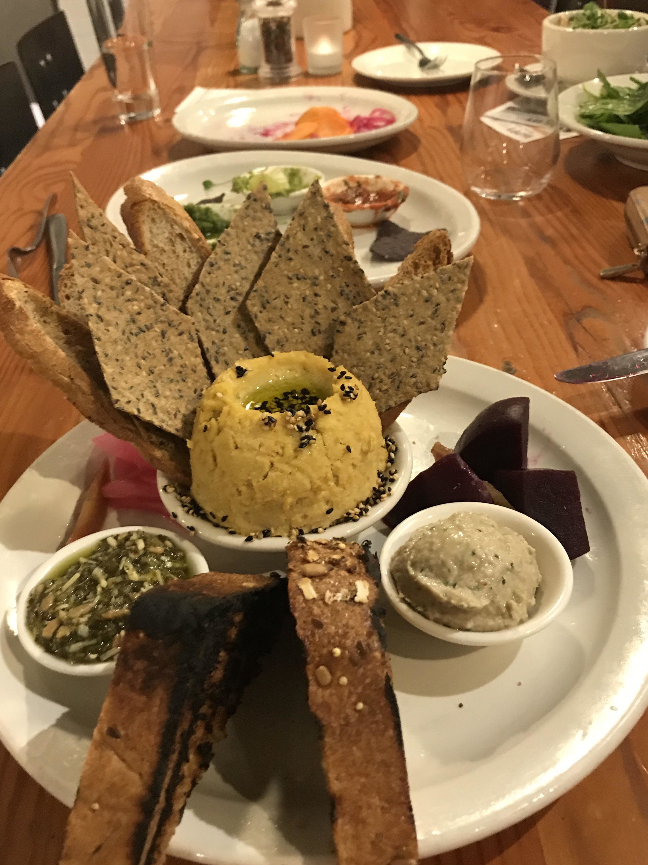 The Crostini and Cracker plate on the dinner menu features housemade bread and crackers, using flours milled by the company that nominated Birchwood Cafe,  B  aker's Field Flour & Bread !