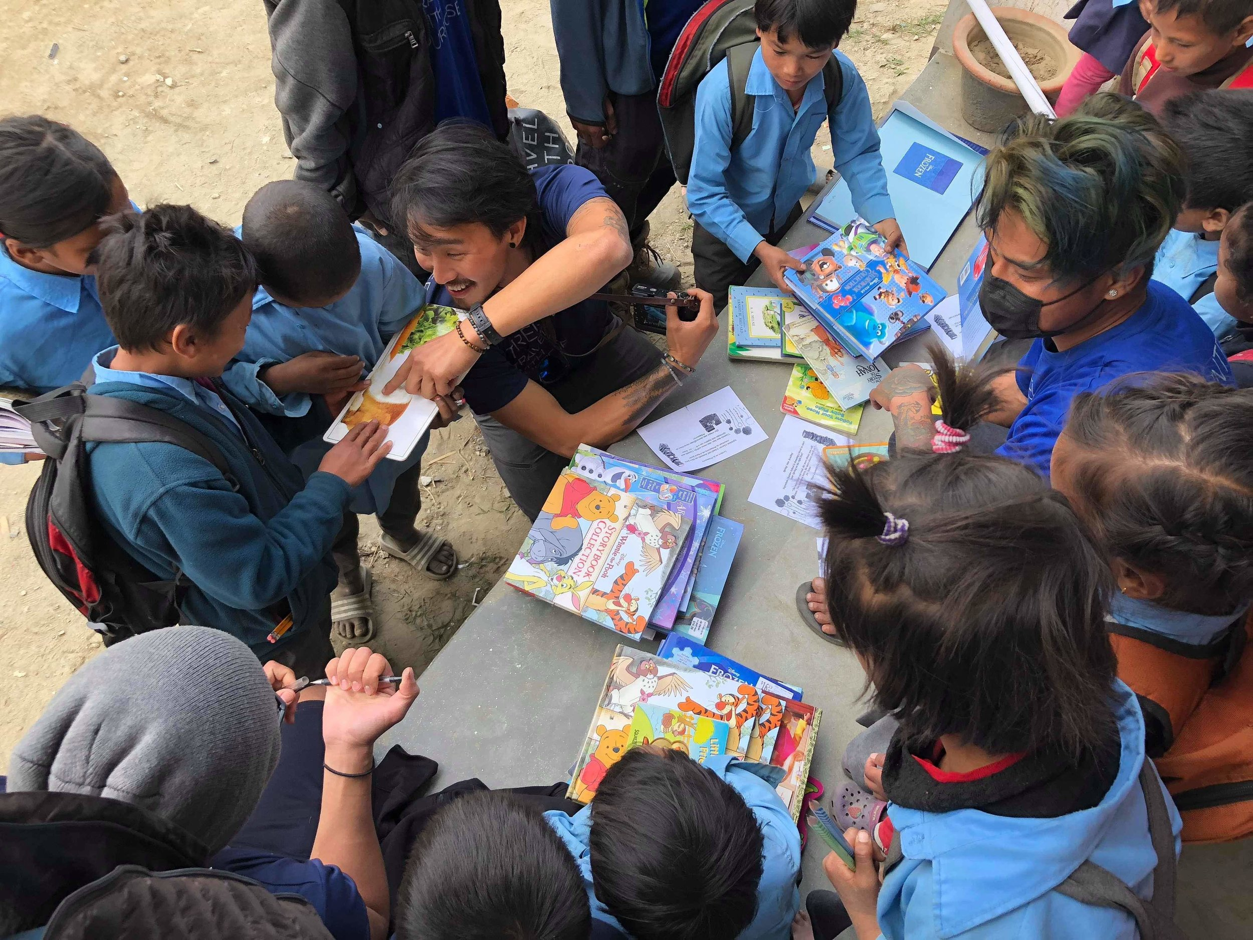 Donated books and supplies are eagerly received by school children