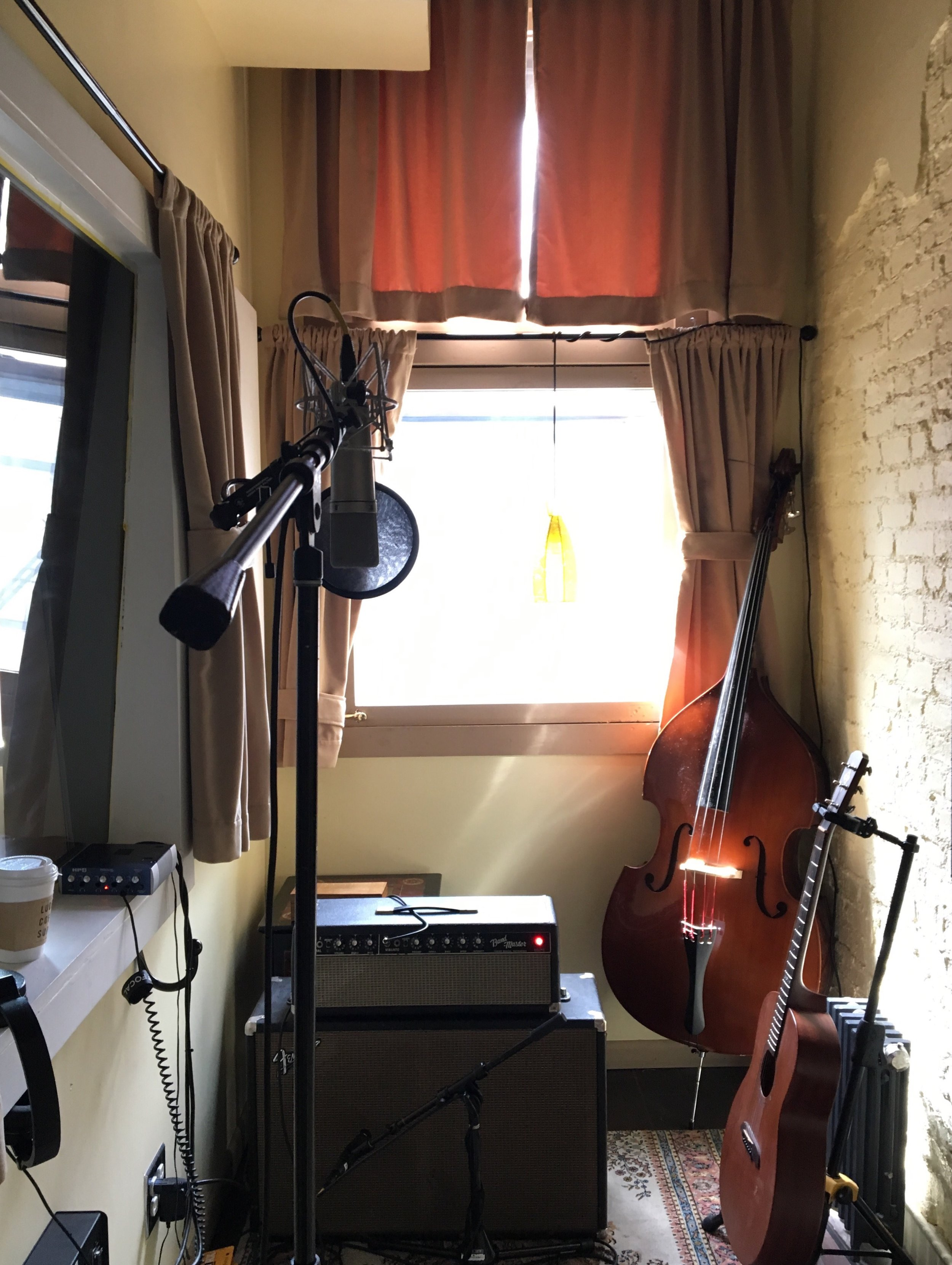 I really came to be so fond of this tiny little booth — I often watched the late afternoon sun fade to early evening standing here, singing my heart out into a mic. It felt like the carpet, the walls, all absorbed the crazy emotion I was giving off in that room.