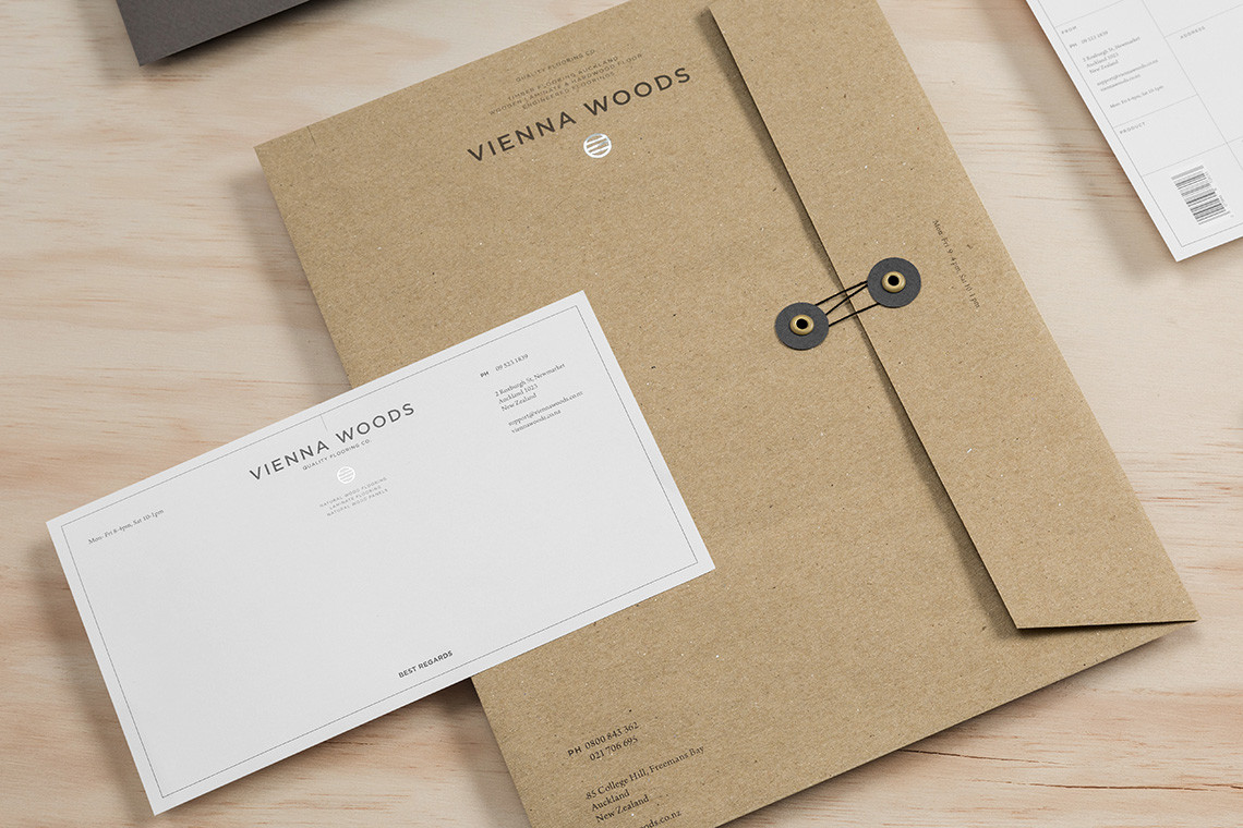 The contrast in layout (Simple versus the tiling inspired grid peaking in the upper right corner) with simple silver foil of the logo.  Vienna Woods  says  Best Regards.