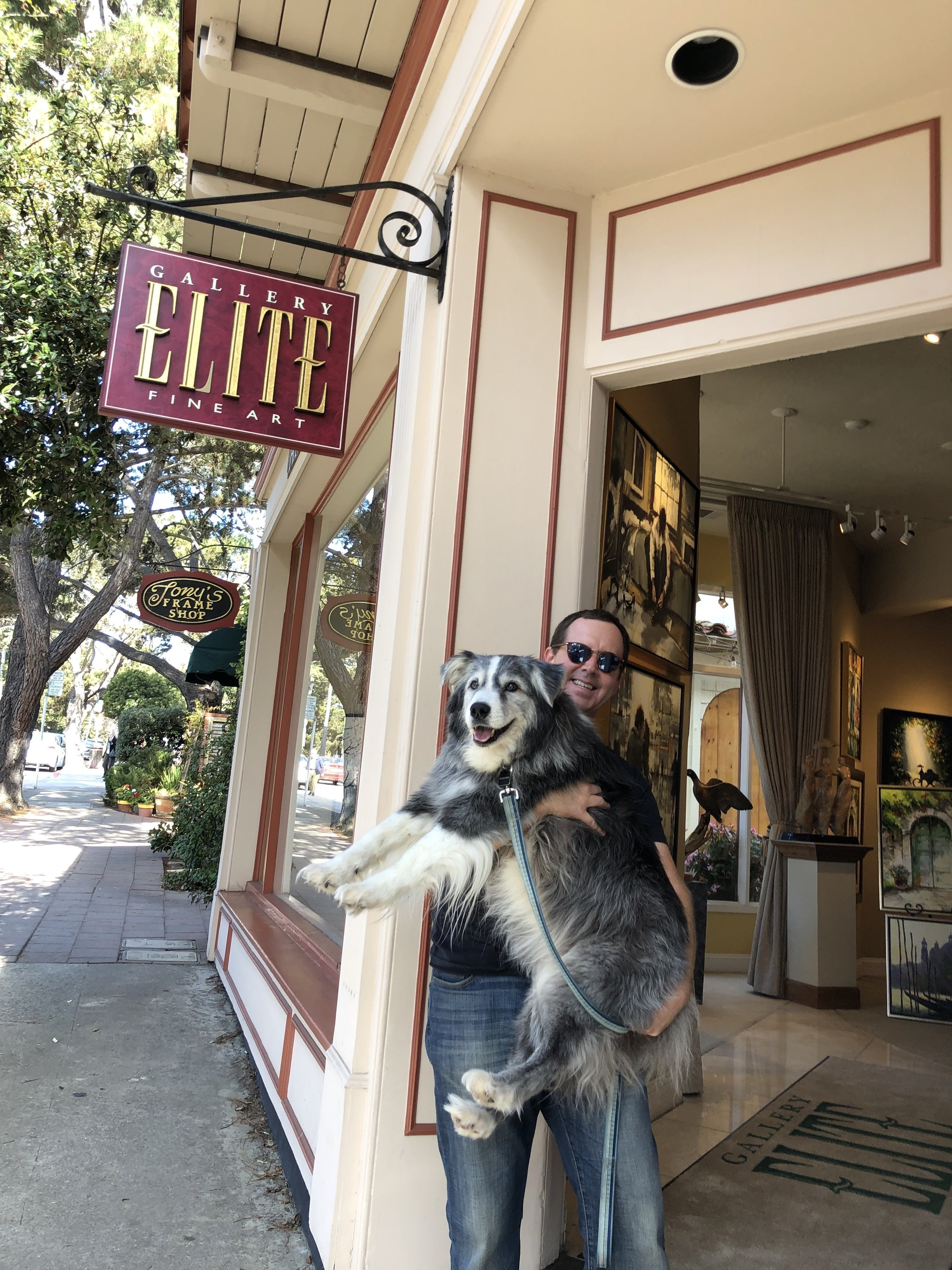 """Me and Kyle celebrating acceptance into Gallery Elite! At 17 years old I needed to carry him around when he had enough walking. Funny story…the Gallery Director asked me use """"Artist With The Cool Dog"""" in an email subject line so she would recognize it's from me."""