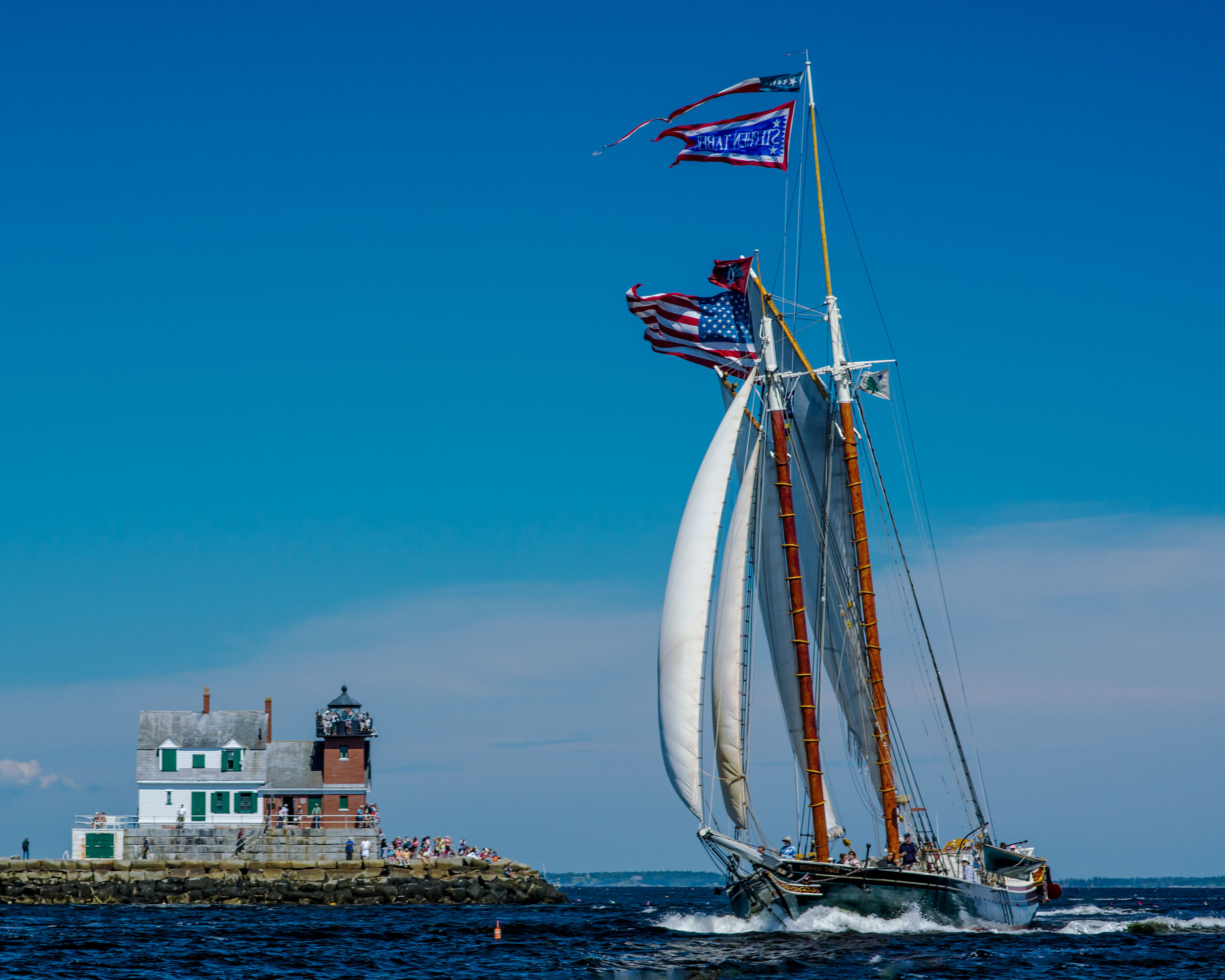 The  Taber  rounding the Rockland Breakwater Lighthouse. Photo: Charles Durfor