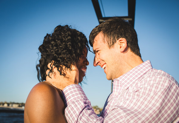 side close up portrait of couple on pier in golden sunlight