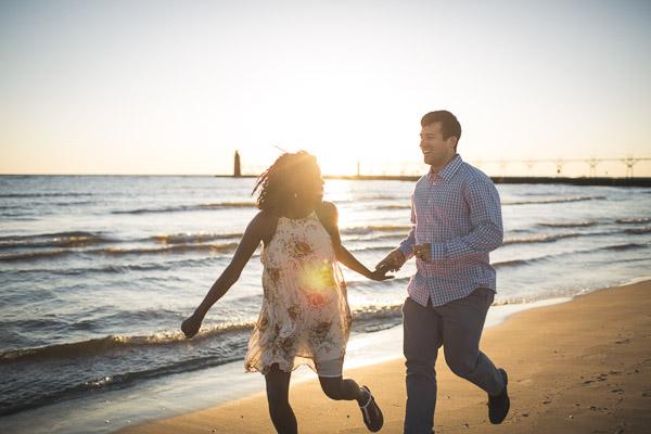 couple running along beach, full of joy