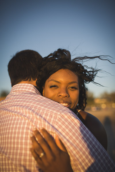 close-up portrait of woman in embrace with husband, intimate connection