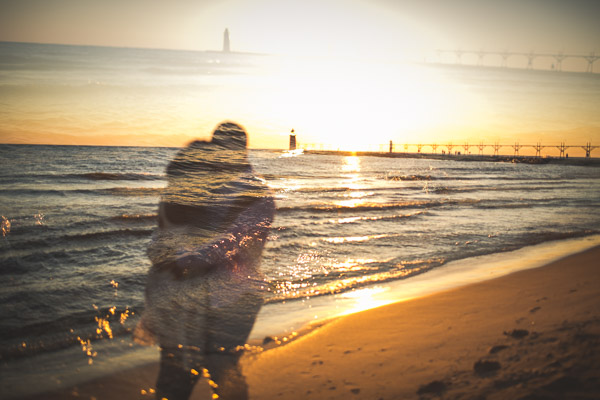 multiple exposure of couple embracing on beach with sand