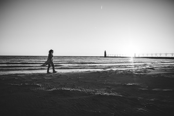 walking along beach with movement of scarf, emotional, black and white