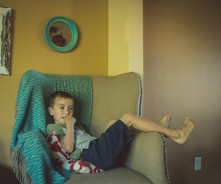 boy relaxing in chair