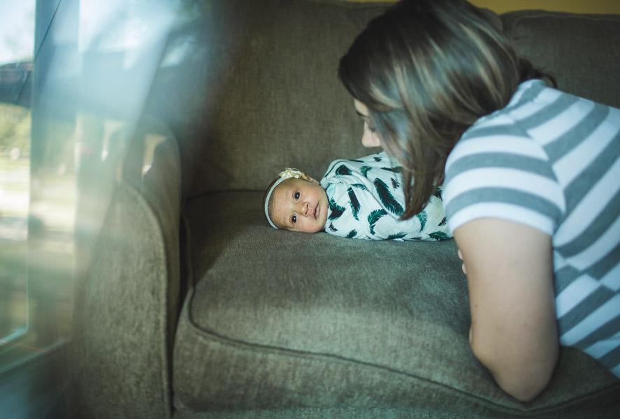 mother admiring newborn child in prism light