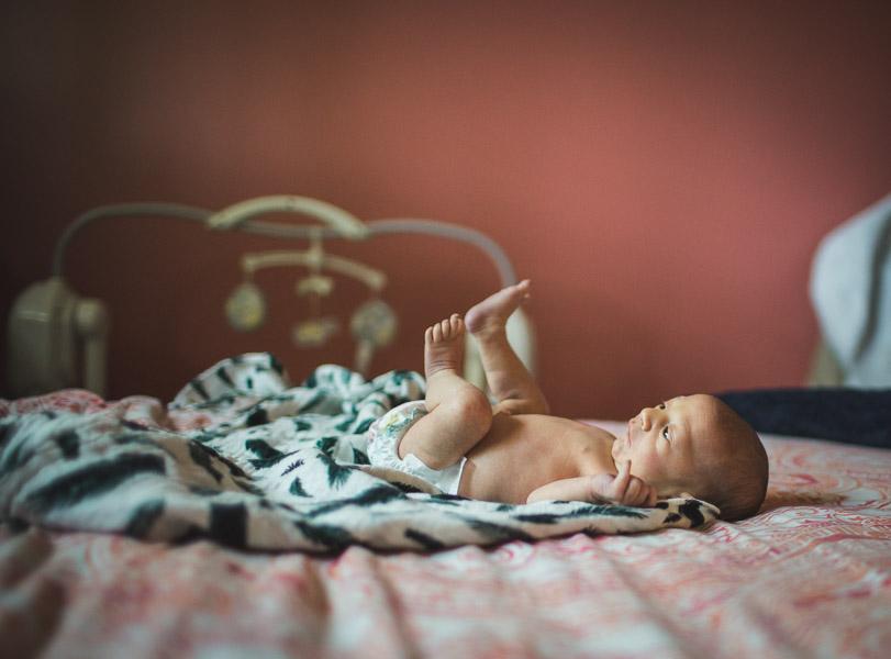 portrait of newborn baby on bed