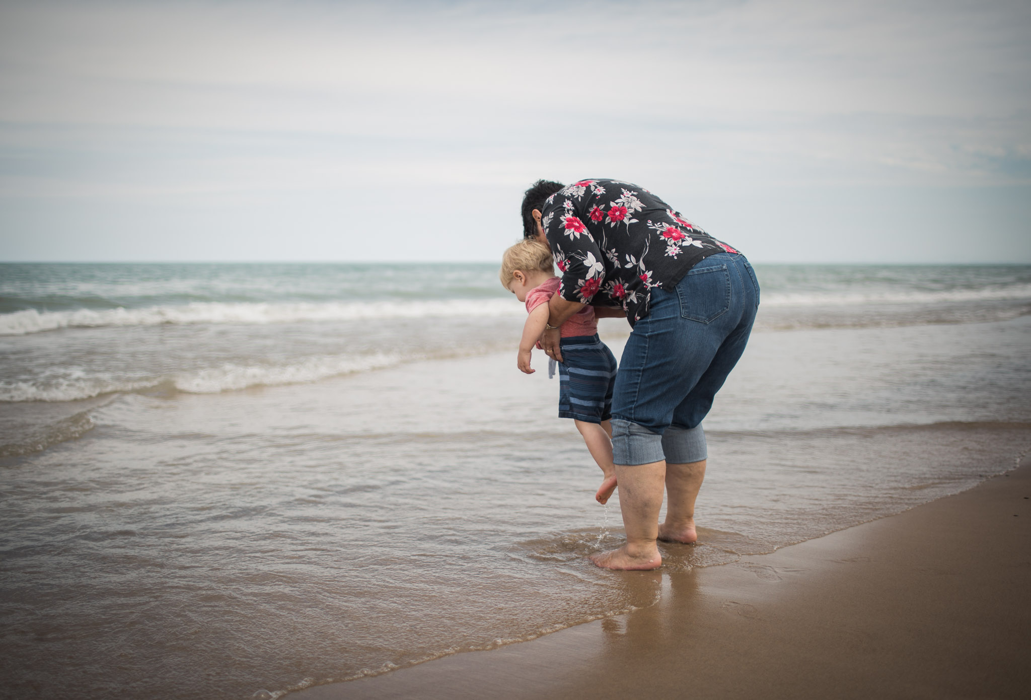 Little boy exploring the ocean with grandma, Family Lifestyle Session off of Lake Michigan