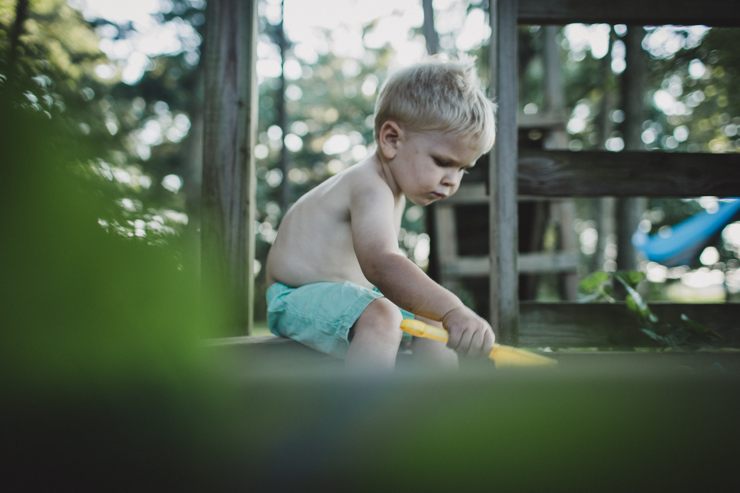 Layered image of boy playing in sandbox