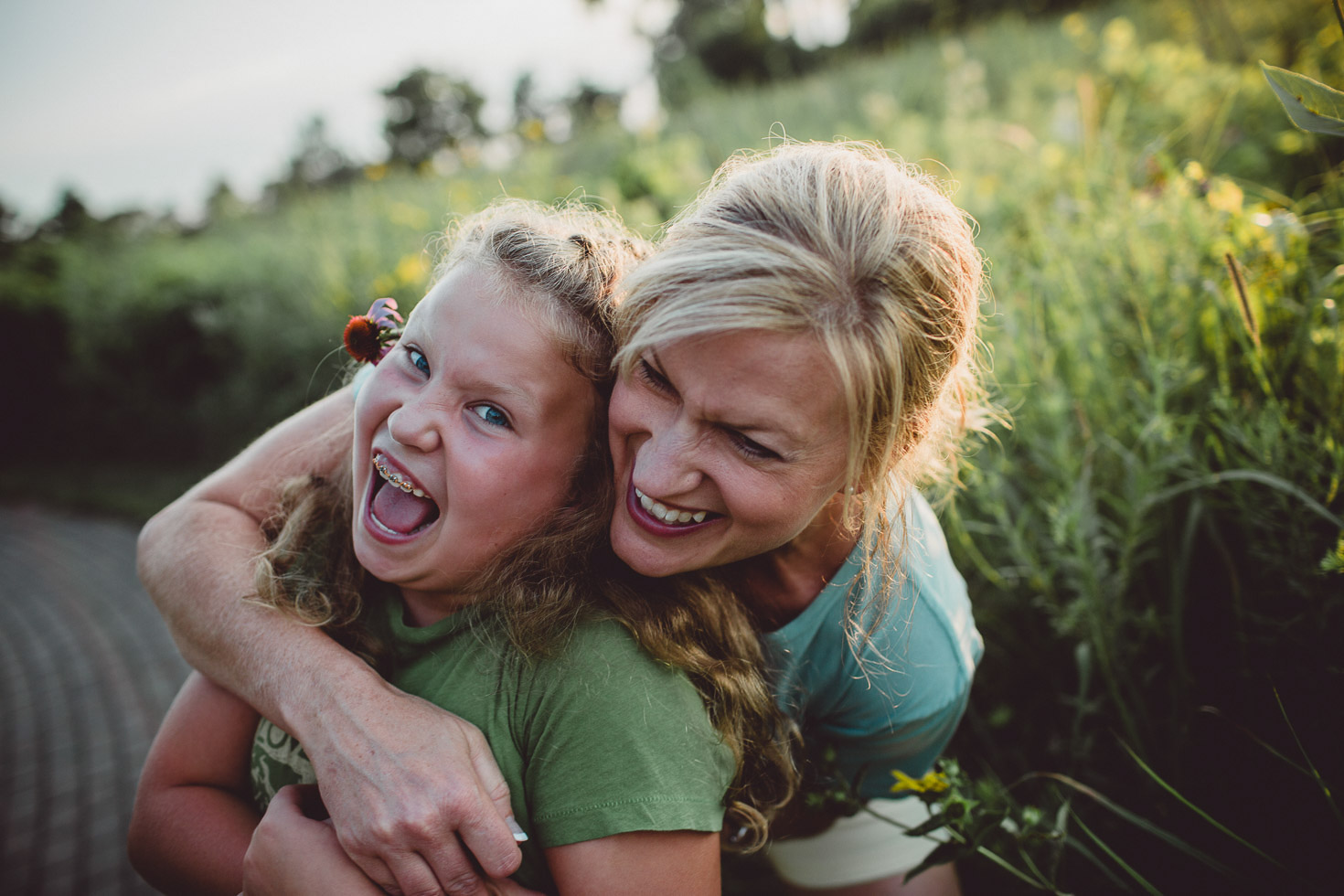 mother and daughter laughing in a warm embrace, connection