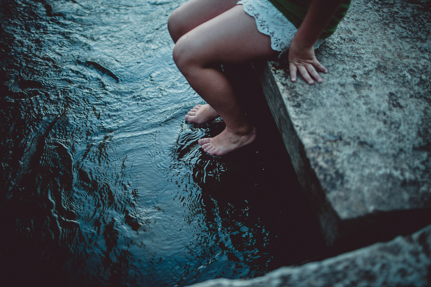 girl dipping her toes in the water