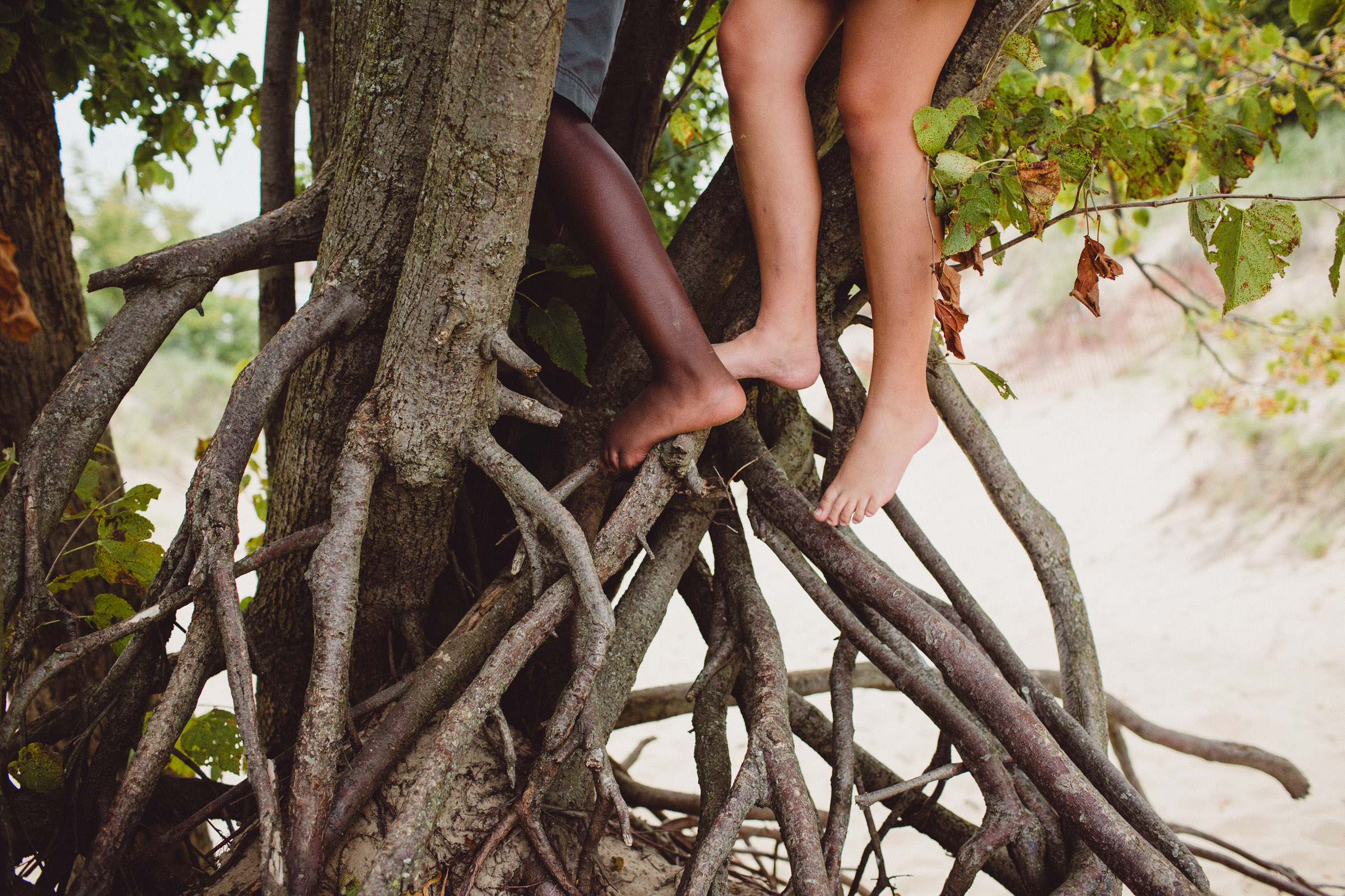 detail image of feet of children climbing trees