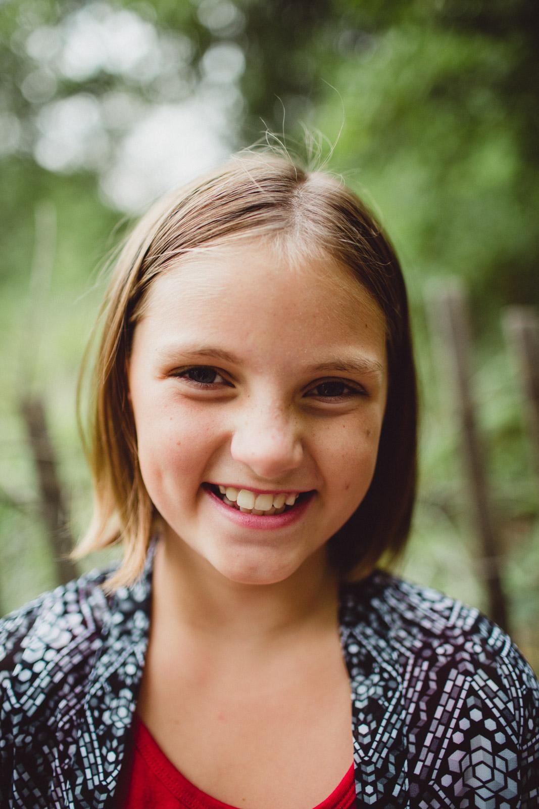 close-up portrait of young girl, joyful