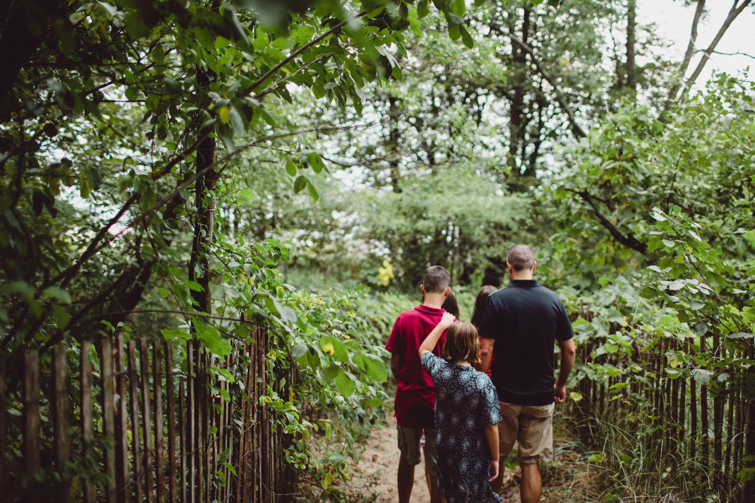 family exploring together through forested trail