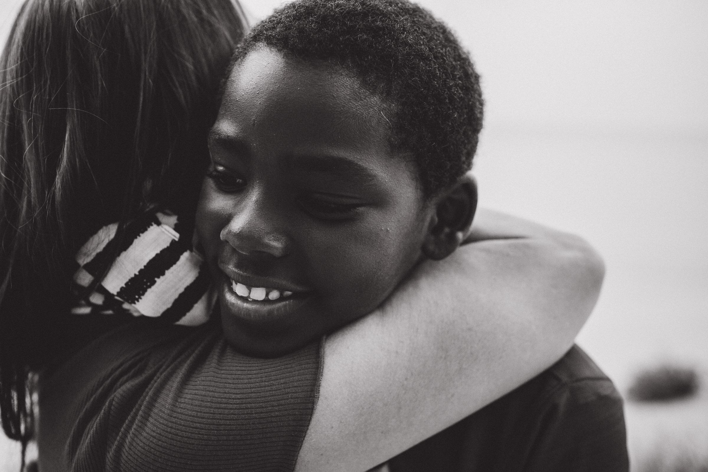 a son giving his mother a giant hug