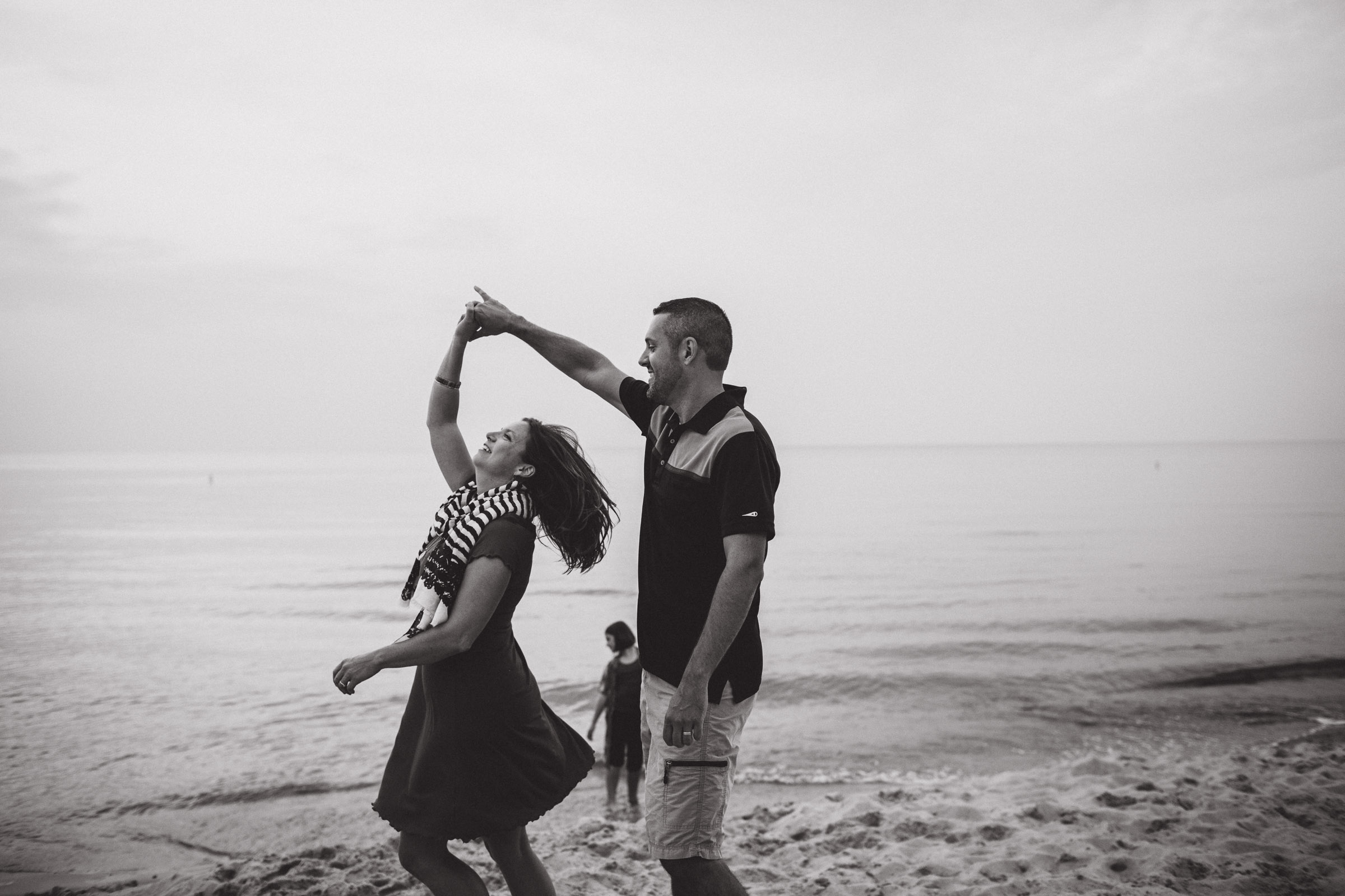couple dancing on the beach, black and white