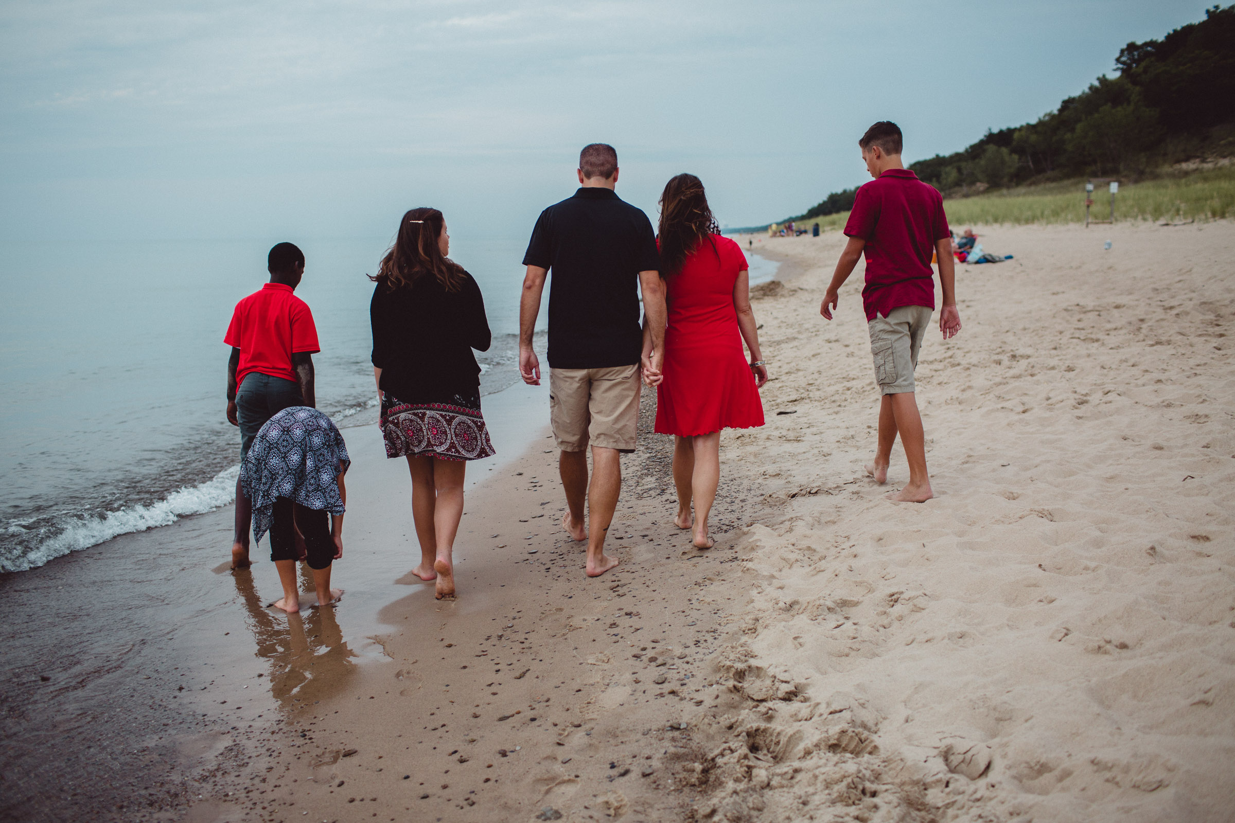 family walking together along beach front