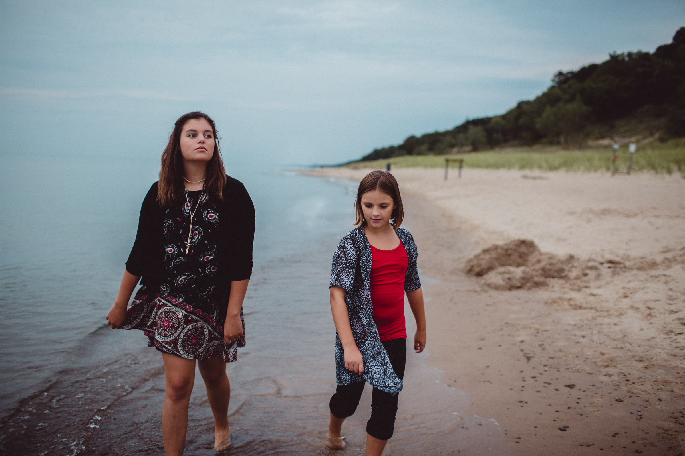 girls walking by the water
