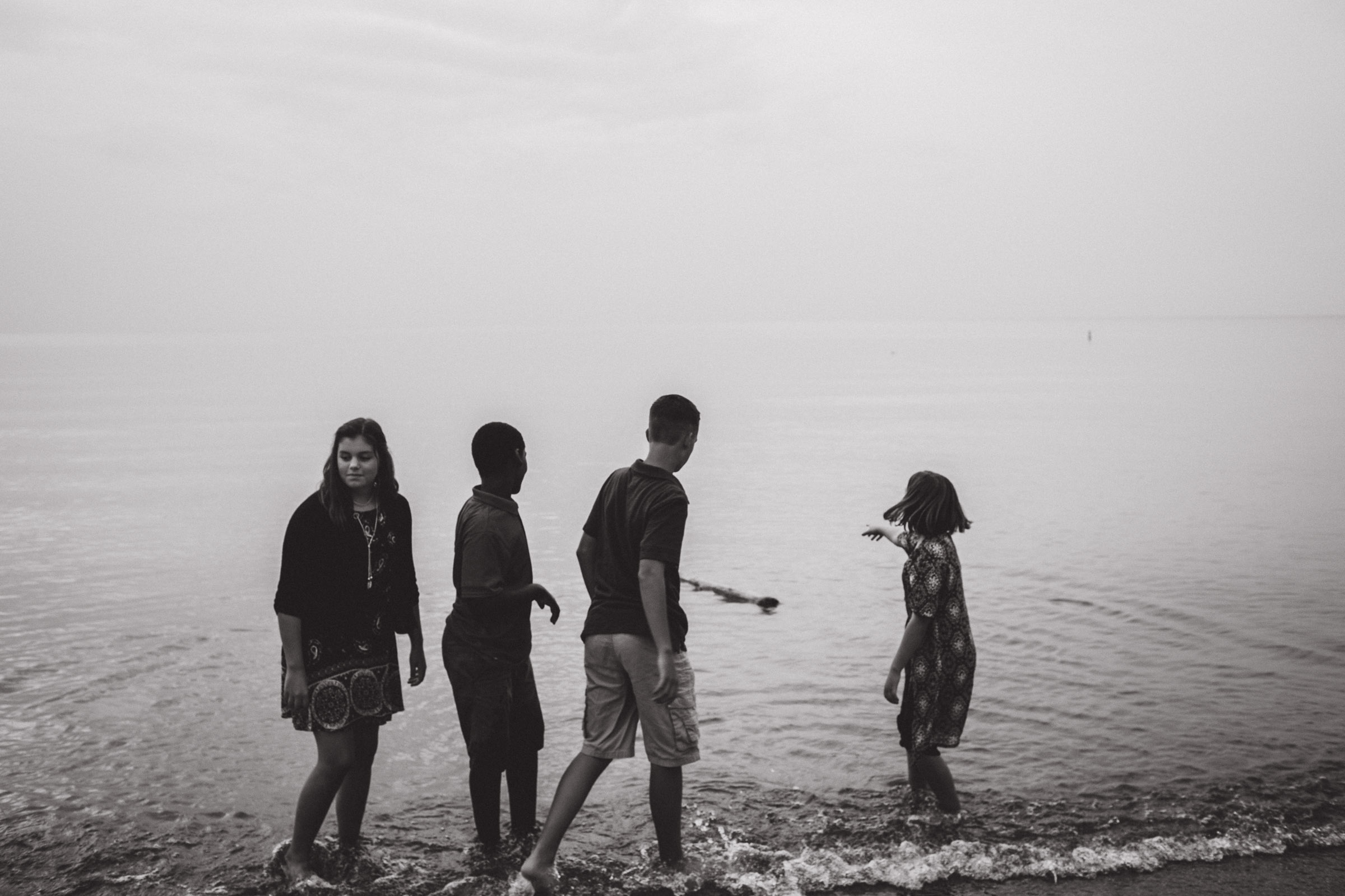 children playing by the water