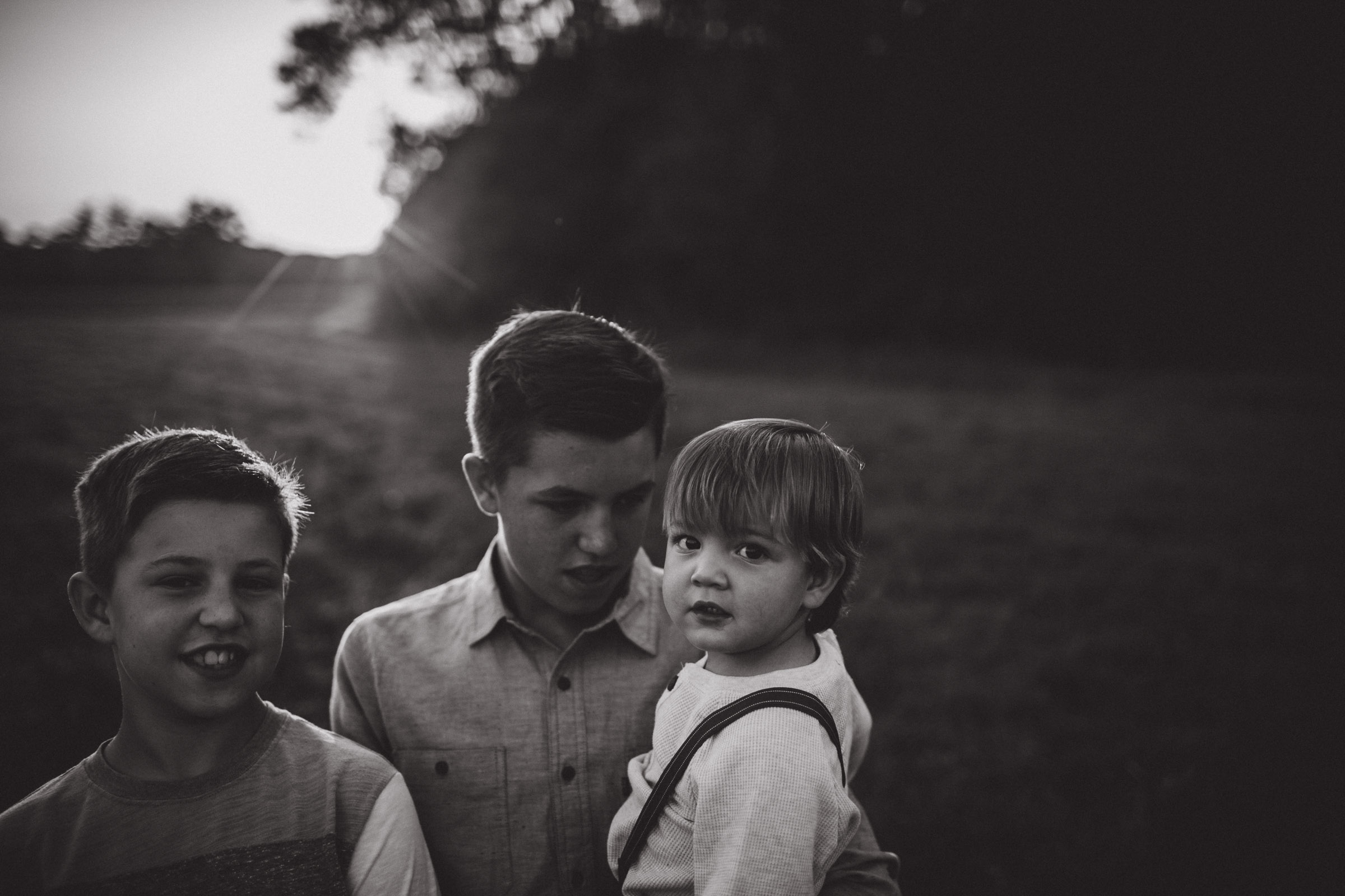 boys taking care of their younger brother, BW Portrait