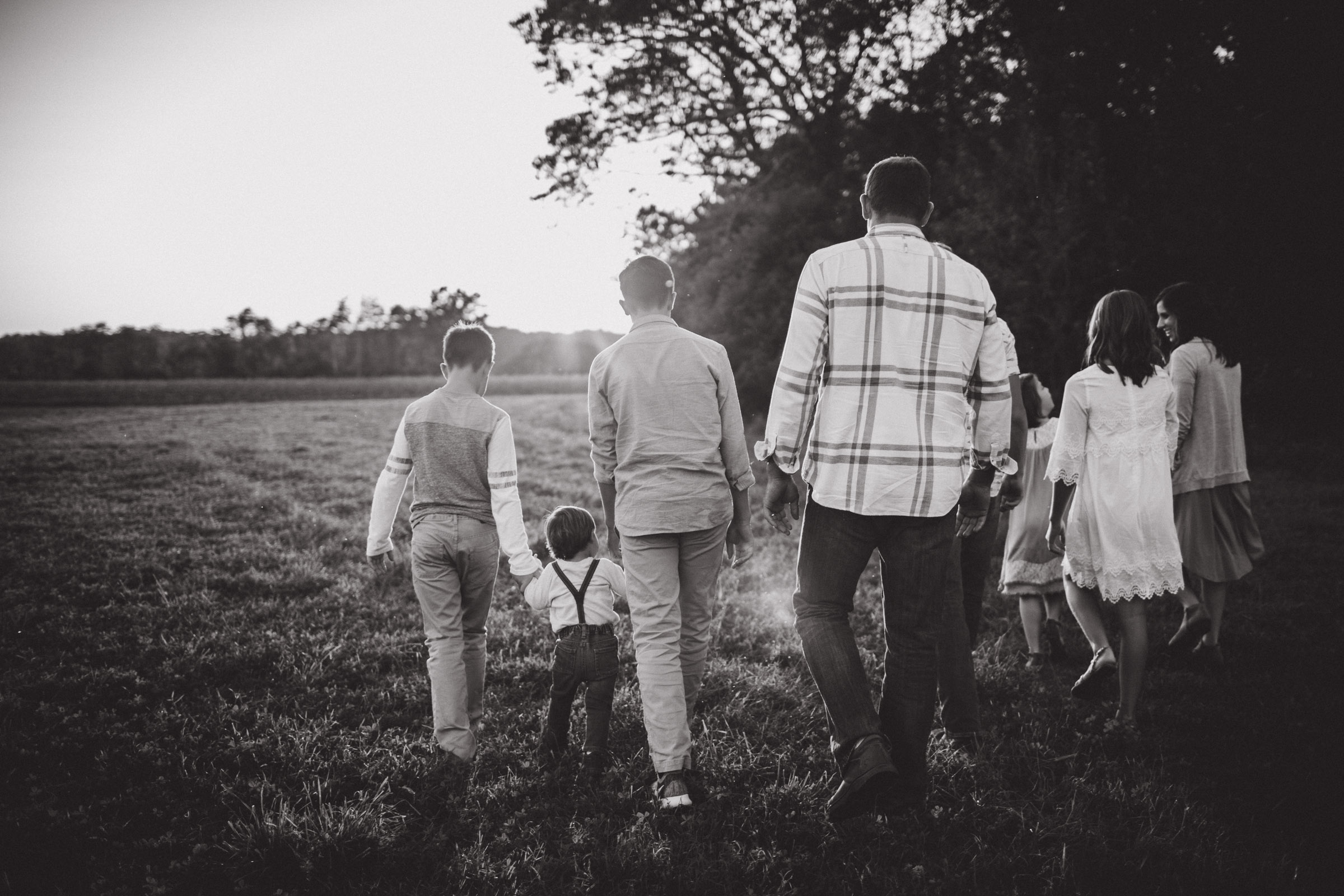 family walking together in field, BW