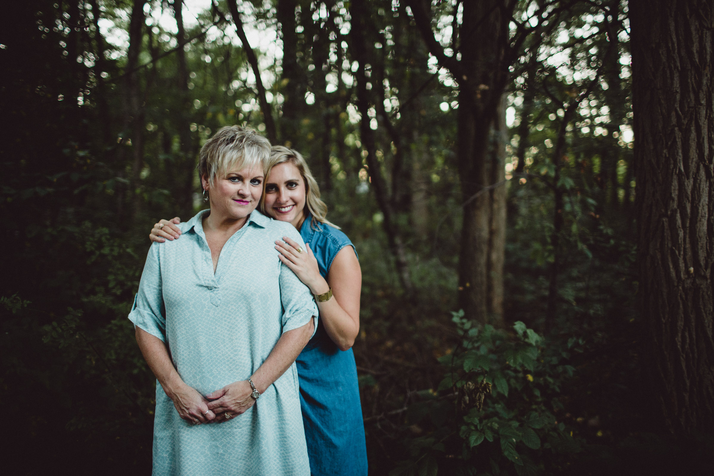 mother and daughter portrait in woods