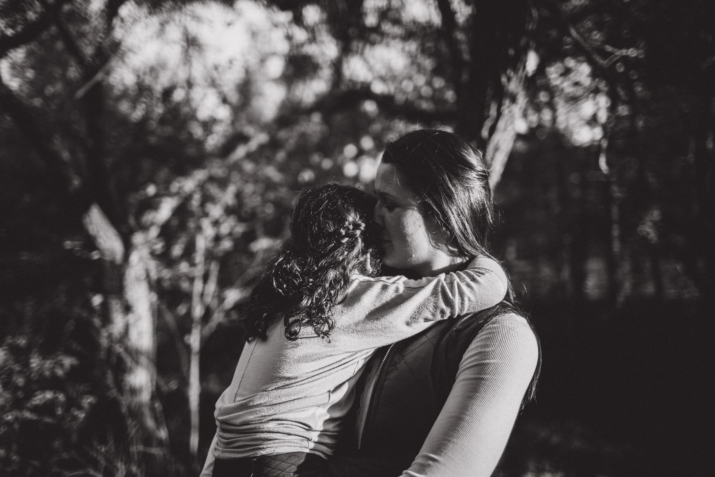 mother and daughter breathing each other in, black and white image