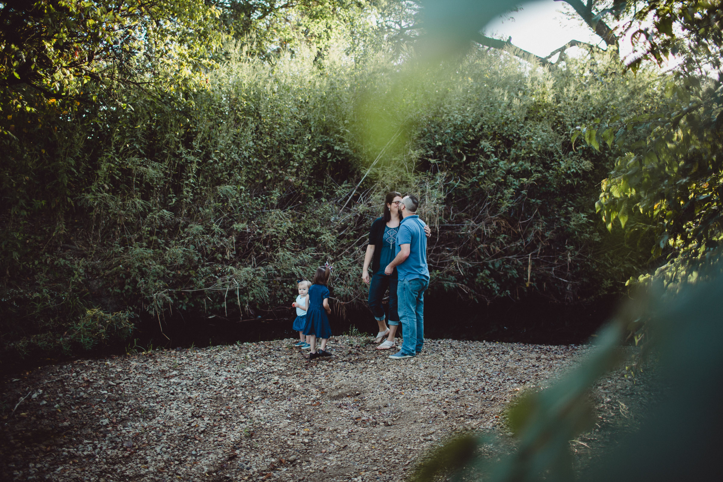 Image of family playing by the creek