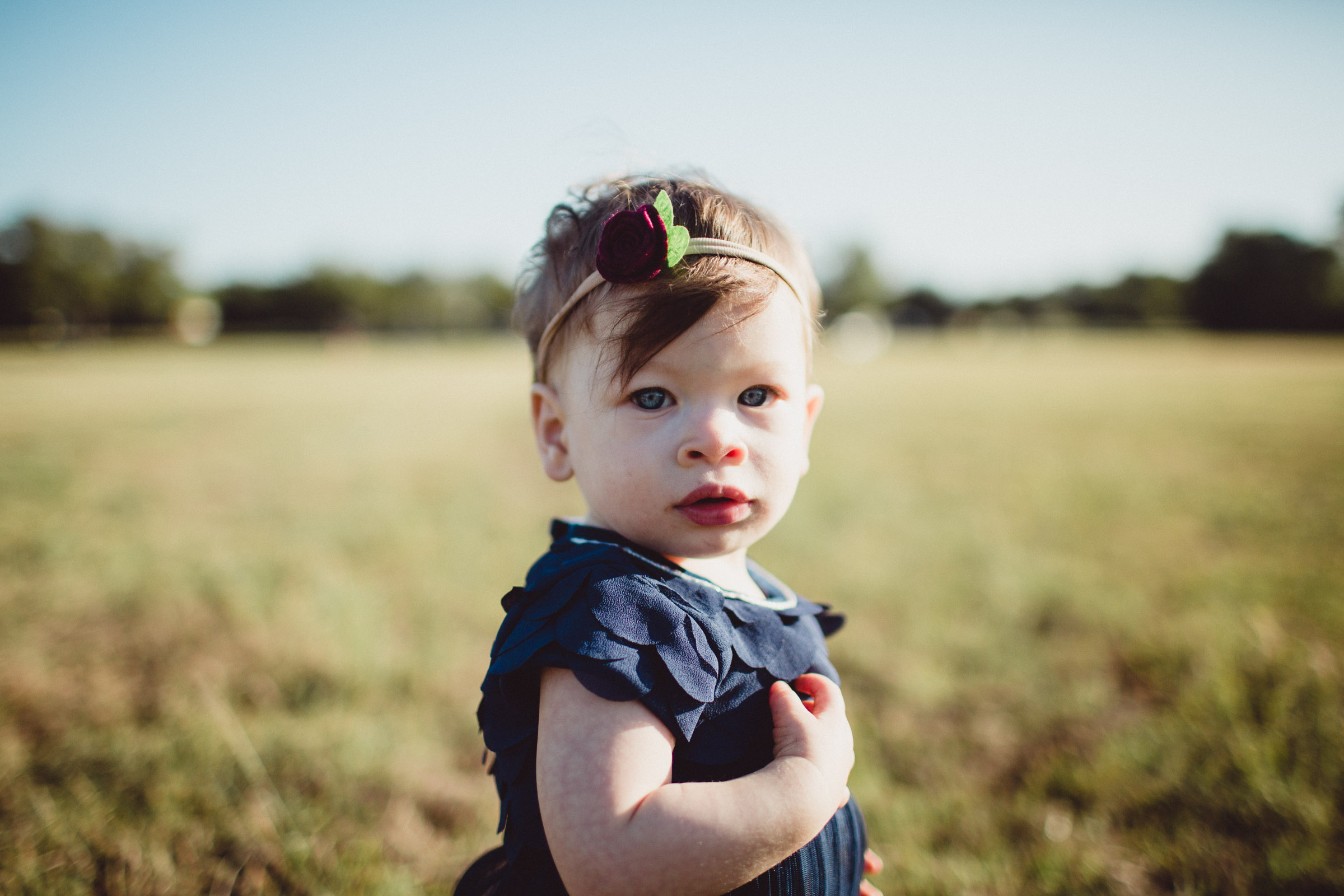 Portrait of toddler girl looking straight into camera