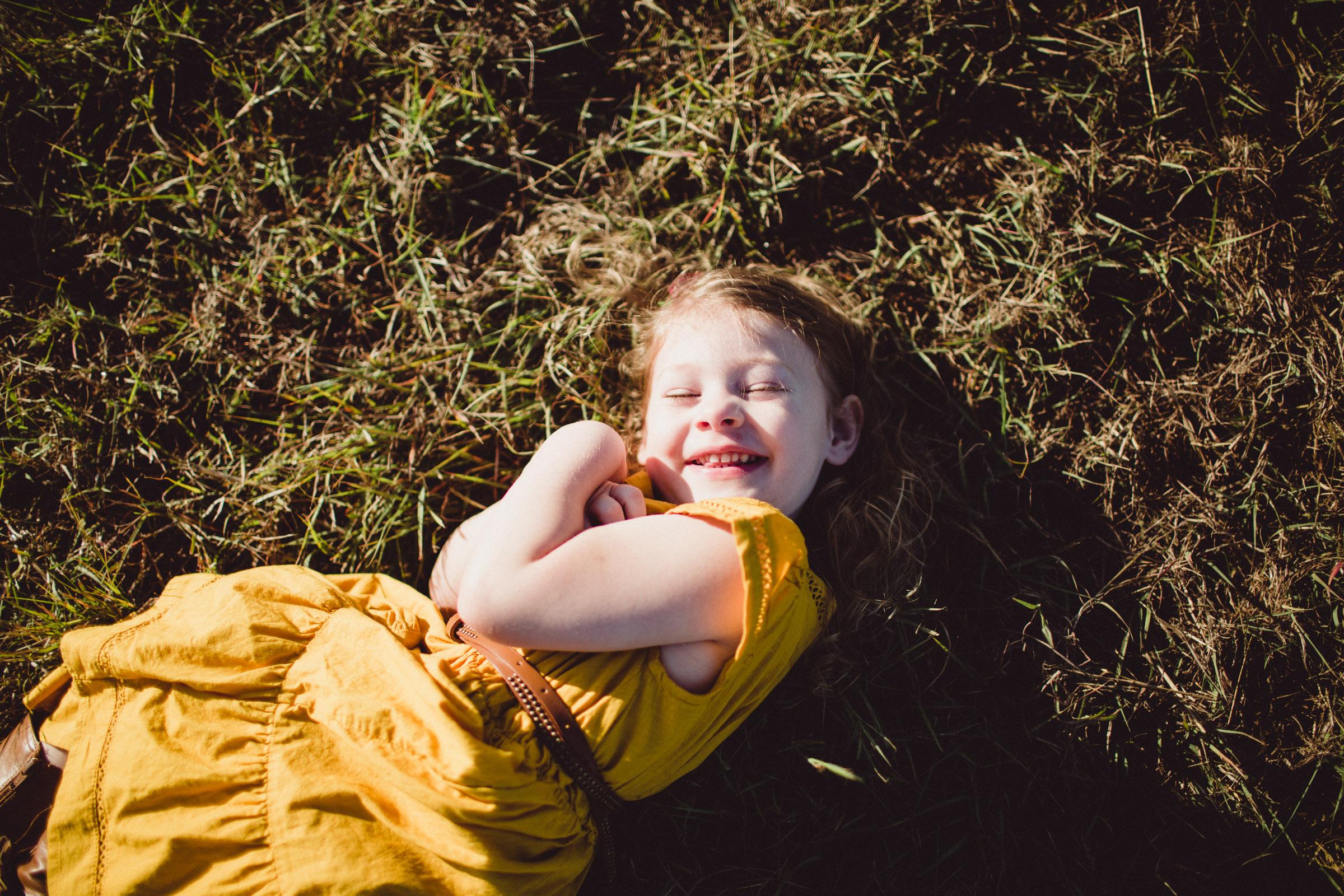 joy of little girl, overhead shot of laughter