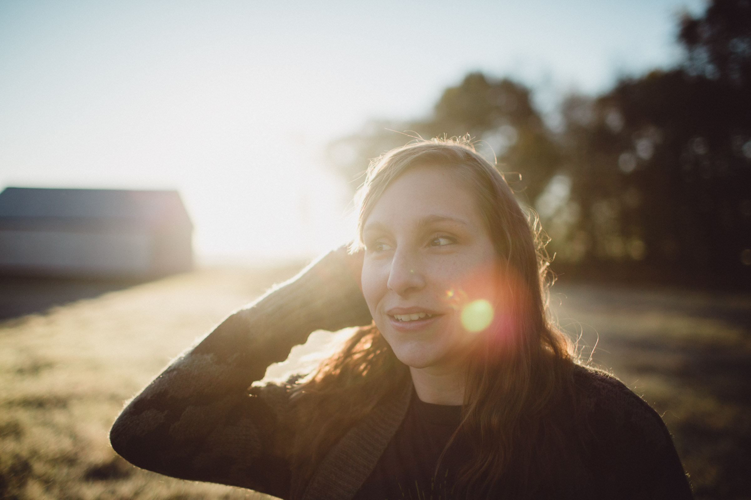 Portrait of girl with backlight and sun flares streaming in