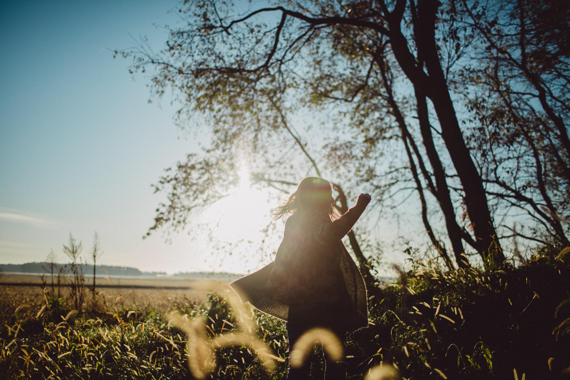 Girl Dancing in Joy in a cornfield