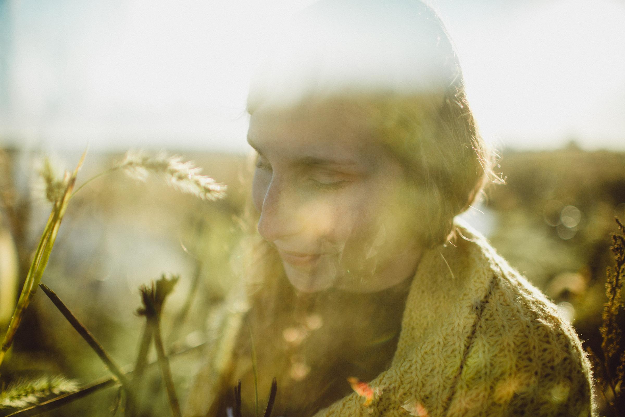 Double Exposure Portrait of girl in field